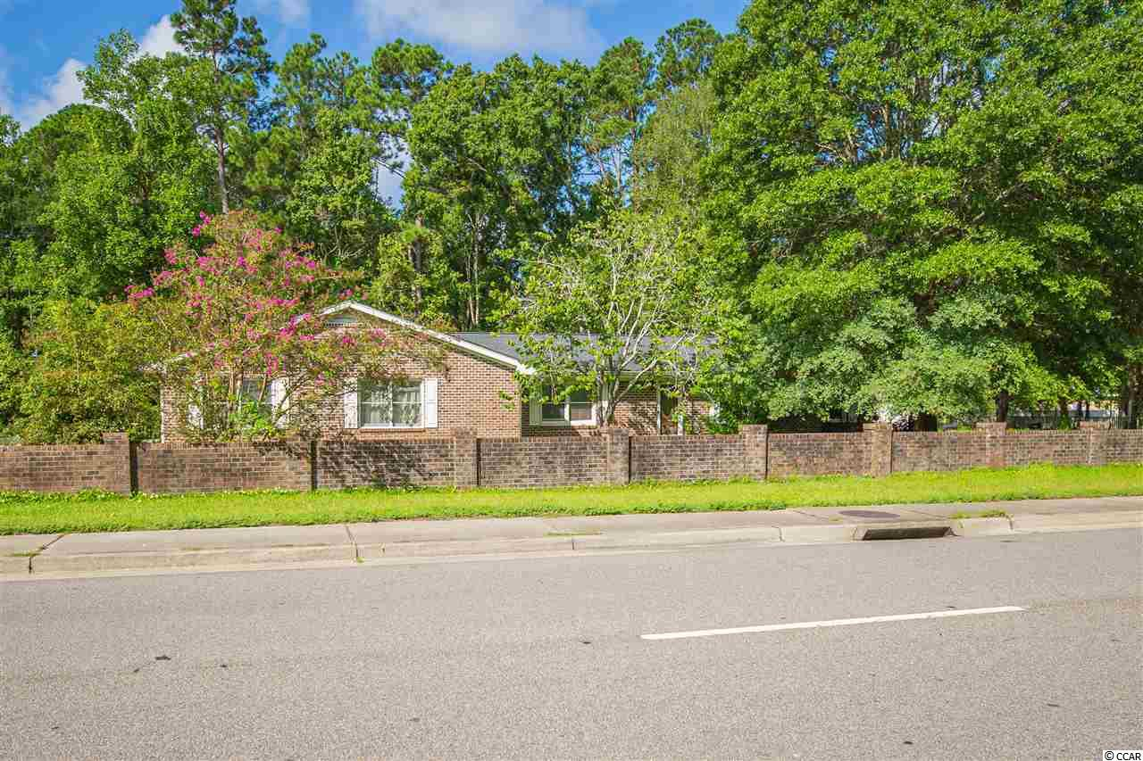 This is an all brick home on two lots, .75 acres, centered between the Myrtle Beach and Surfside area on 544. Being on two lots and no HOA, owners could add another building, RV, or pool!  Grass and green space is abundant and has plenty of parking.  Inside, there is custom shelving and storage, spacious rooms, real stone fireplace, central vac, and reverse osmosis system for the water.  This home has a lot of potential and options for additions outside.
