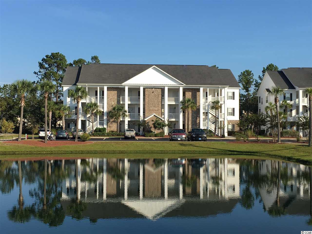 You have to see this amazing view for yourself. This gorgeous end unit 3BR, 2BA villa has wonderful views of the lake, so enjoying your morning coffee on your screened in porch just got even more relaxing. This villa will feature the Platinum package which includes; white all wood soft closed cabinets, click in luxury vinyl plank flooring, ceiling fans in master and living room. Other amazing features of this home include 9ft ceilings, granite countertops in kitchen and matching granite in all bathrooms, screened in porch, outside storage unit, walk in closets and more. This community will be totally gated once the last building is completed, low HOA fees and only 2 miles to the beach. This property is so centrally located on the South end to everything. This is a perfect primary home, second home or beach retreat. The units are all on one level and the care free living provide by this community gives you the full essence of coastal living. This building is currently under construction (pictures are of our current model and not the actual unit for sale) and has an estimated completion date of December 2019 (that can change). We do have an on site model available to see everyday; the model hours are Monday - Friday 10am-4pm, Saturday 12pm-4pm and Sunday 12pm-3pm. Stop by and tour these gorgeous homes for yourself. All Sq. Footage is approximate and not guaranteed, buyer is responsible for verification.