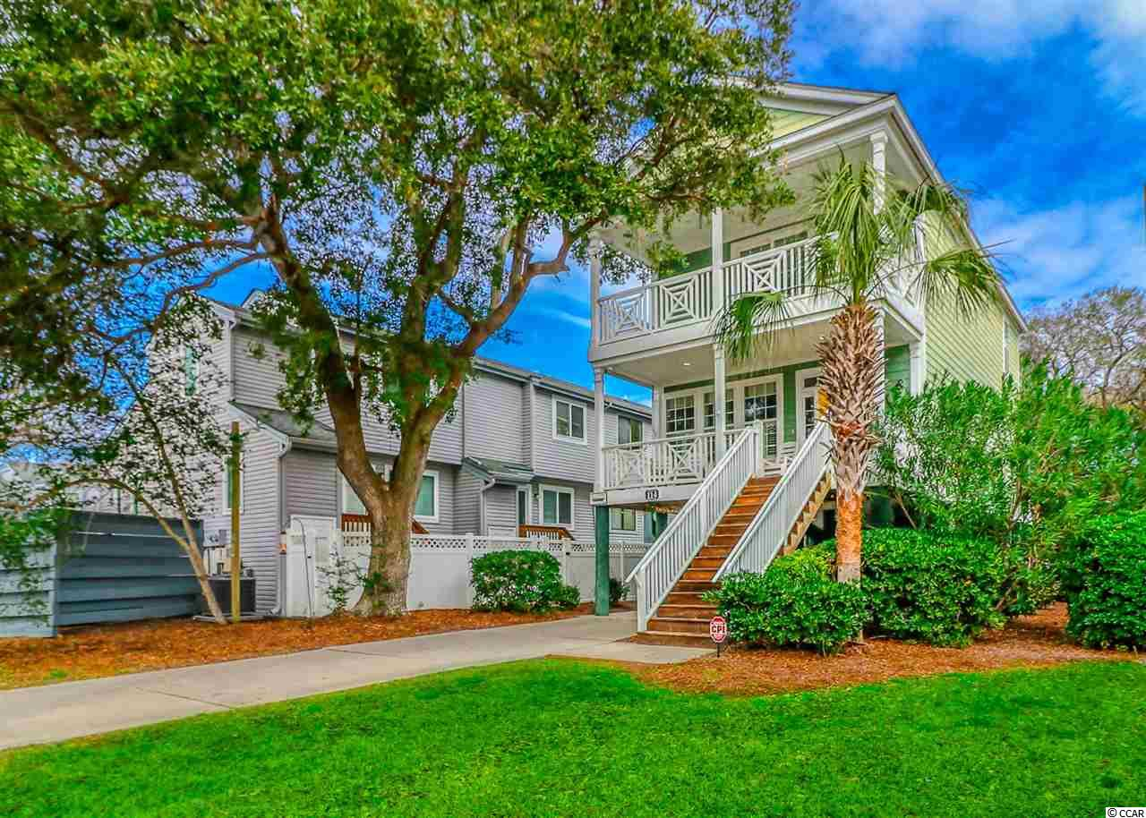 This is a 3-bedroom, 2.5-bathroom raised style beach home located in Surfside only about a 1/2 block from the gorgeous family-friendly Surfside Beach and Atlantic Ocean.  Being part of the Portobello IV community, located 0.7 miles north of the Surfside Pier, this house has access to a pool (approx. 14 x 26 feet) that is shared with only 5 other homes of the community.  HOA handles the pool and lawn maintenance.  This home offers two levels of covered porches on the front with ocean views as well as a rear screened porch which overlooks a private oasis of a fenced  backyard that features a large ground-level deck and hammock under the shade of hardwood trees.  The first floor of this home features an open kitchen/dining/living area floor plan.  The well-equipped kitchen features a breakfast bar that offers plenty of seating.  Also on the first level is a full-size laundry room and half-bath.  The three bedrooms are located on the second level, along with two full bathrooms and a storage room that could easily serve as a small office or nursery. The master bedroom has a private bathroom, his & her closets, and a private deck. The two additional bedrooms share a Jack-and-Jill bathroom. Additional features of the home include wood grain plank-style flooring throughout the first floor, plantation shutters throughout, current coastal decor, tile flooring in all bathrooms, Hardi-board concrete fiber siding,enclosed attached storage room under the house, outside shower, covered and driveway parking for 3-4 vehicles, and more.  Being sold fully furnished, rental ready.