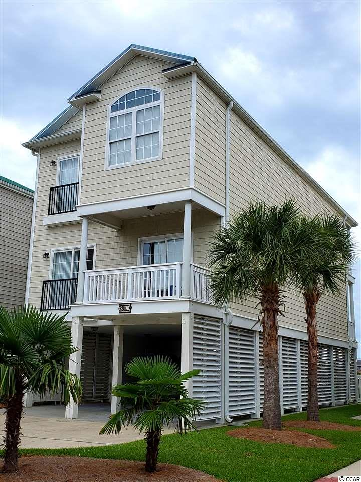 Beautifully furnished raised beach home overlooking the marsh.  One of the few homes in this subdivision with pool outside of home. GORGEOUS VIEW! Perfectly decorated and all furnishings are included. Elevator. Multiple balconies. Walking distance to dining, shopping, & more. Close to the beach!