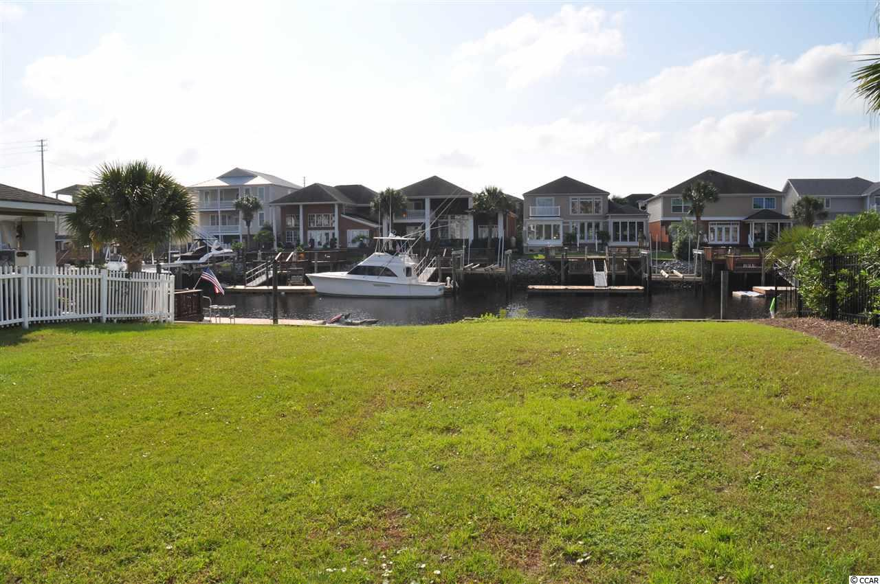 Great opportunity buy a waterfront lot in an excellent neighborhood.  Deep water year round.  Nice protected channel off of the Intracoastal Waterway.  Best place to keep your boat because there is no waterway abuse from boat traffic.  Neighborhood handles the dredging projects to keep the water deep too.  Perfect area to build your dream home.  Close to the beach, restaurants, shopping, and on the water. What else could you ask for?