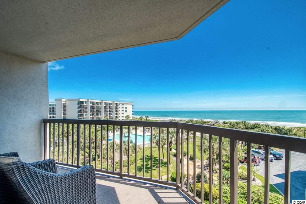 Spring is on the way. Time to head to Litchfield by the Sea. A peaceful, relaxing destination with beautiful beaches and trails to walk, jog or bike. Hardwood floors welcome you into this updated, fully furnished, beautifully decorated condo. You will find upscale finishes with an open area floor plan that lets you see amazing oceanfront views from the kitchen and living room areas. Sleek finishes are also in the Master bedroom and bathroom areas. Plenty of room for family and friends to gather and relax. Out on the balcony you will feel the ocean breezes and see the spectacular view of the ocean, dunes and palm trees, and the lovely resort swimming pool too. This property can be used for summer vacations, weekend getaways, and vacation rentals when you're not in town. It has a great rental income history. There is an assigned parking space under the building with additional parking around the building. A locker near the parking area lets you keeps your beach chairs. surfboards, fishing rods stored in one place. There is a patio area for grilling if you feel like eating in at night or make a reservation at one of our favorite local restaurants. Within the gates of  Litchfield by the Sea are tennis courts, swimming pools, walking or jogging trails, and fishing docks. A  fitness center, spa and salon are close by to make you feel and look even better. Litchfield by the Sea is located 60 miles north of Charleston, SC and 30 miles south of Myrtle Beach, SC. Come take a look and make an offer on this beautiful property that will provide a relaxing, fun, and memorable time at the beach.