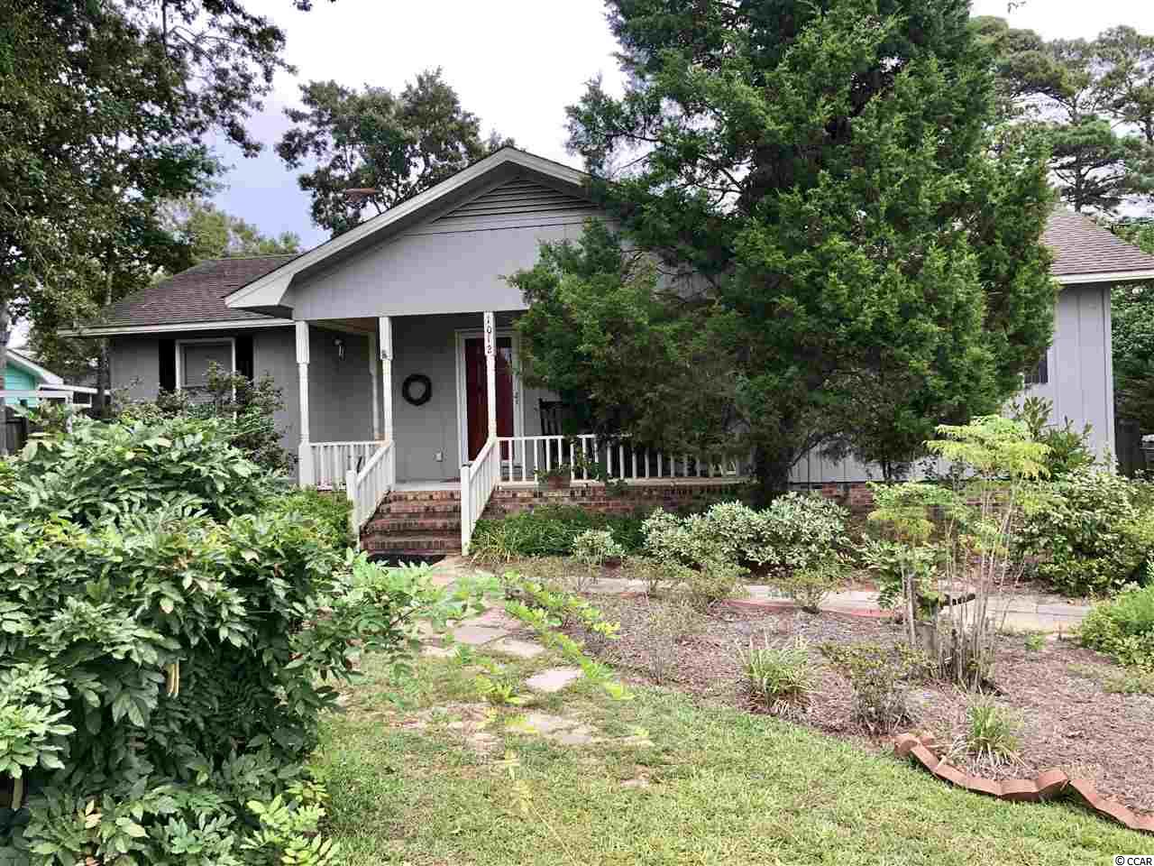 Adorable Beach House in the north end of Surfside Beach.  Close to Dogwood and Elizabeth Lakes.  Well cared for home is desirable neighborhood.  Kitchen has been updated.  Living room with dining area, Sun Porch, separate laundry room, split bedroom plan.  Lots of trees and lush landscaping,  Buyers will love this home.