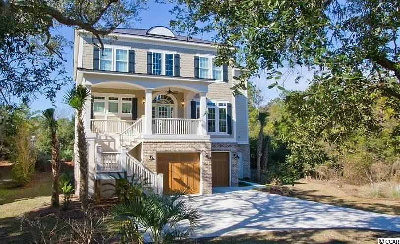 """Sophisticated coastal charm abounds in his gorgeous, """"almost new"""" home located close to the beach in DeBordieu Colony! With 3200 htd.sq. ft, 5 BRs and an elevator, it's perfect for the whole family! Design features including brick accent walls and arches throughout the downstairs living areas are complimented with beautiful hardwood floors and ship-lap siding. The living room features a gas fireplace,built in cabinetry and a gorgeous coffered ceiling. The kitchen is open to dining and was designed for a chef, with top- -of-the-line appliances, farm sink, gas stove, double ovens and a large, walk-in pantry. The screened porch and open deck are easily accessible from the dining and living areas. The master suite offers his and her closets, separate vanities with granite tops, a large, walk-in shower, marble floors and a footed tub. Also on the main living level is a powder room, laundry room with abundant cabinets, and flexible space that could be used as a den, study, office, or nursery. The top level, also accessible by elevator, offers 4 bedrooms and 2 high quality bathrooms with granite counter tops and tile floors, one of which is a shared """"jack and jill."""" Other features include: crown moulding, wainscoating, instant hot water heaters, foam insulation, metal roof, shake and plank Hardi-board siding, irrigation, French doors, carriage style garage doors, and an abundanceof windows and doors providing maximum light and a gloriously open, airy feeling. The Sellers of this terrific home will consider a one year lease back after closing. Ocean Oaks owners at DeBordieu have the luxury of having deeded access to the perimeter road on DeBordieu Colony's north side, bordering the Vanderbilt estate of Arcadia Plantaion. At the end of this trail is a parking area and beach access for the exclusive use of Ocean Oaks and Ocean Park owners, making it very easy to access the beach by foot, bike, or golf cart. The DeBordieu Colony nature trail, affectionately known to residents """