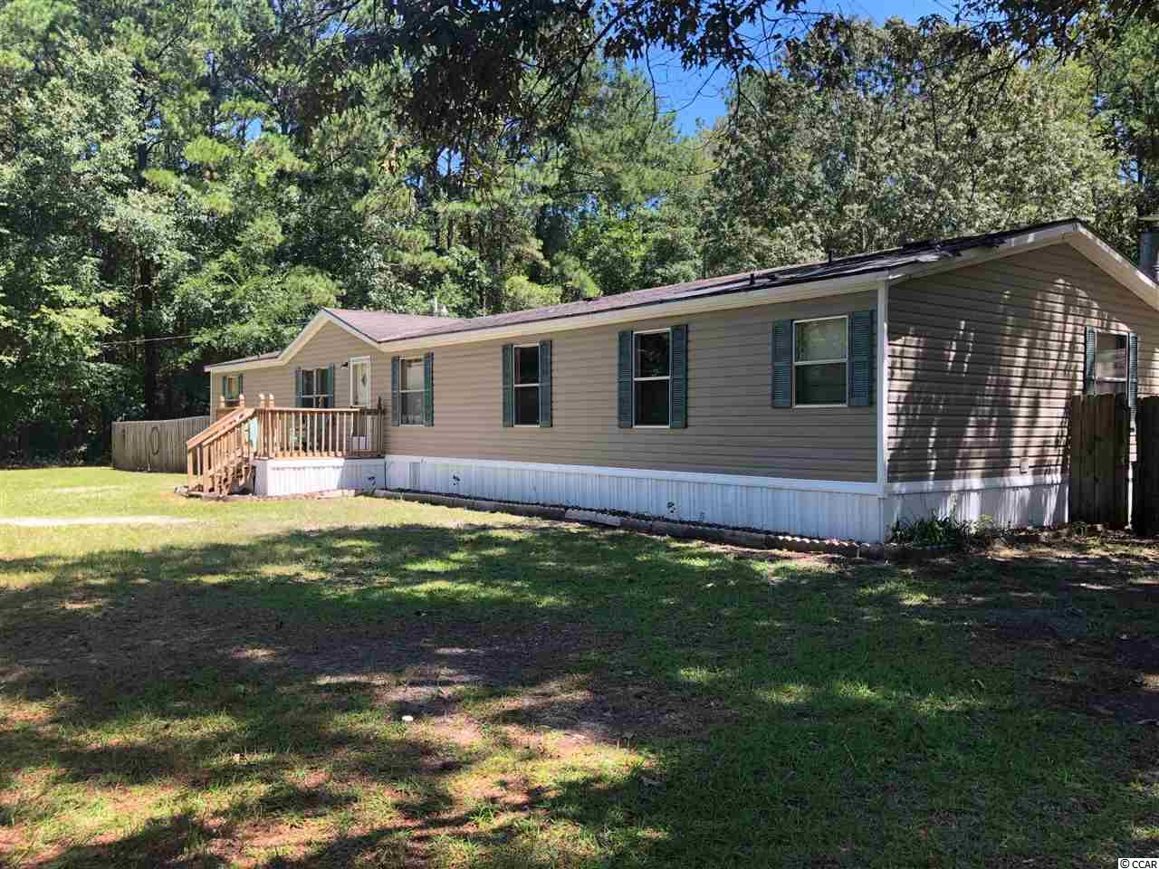 4 bedroom Manufactured Home on 1.03 acres! The Kitchen, along with plenty of counter space, has a Breakfast Room and the Island offers additional seating. Right off the kitchen is the 19x12 Family Room. It has a traditional style gas fireplace. Don't need a Formal Dining and Living Room? They could be used as a kid's playroom and an office.  Small quiet neighborhood with NO HOA! There are 2 large storage buildings and a 2 bay carport in the backyard with easy access from the second driveway and there's still plenty of room to park a motor home, camper and boats. Only minutes to downtown Georgetown and all the third oldest city in SC has to offer. Only 30 minutes to Conway and a short drive to all the beaches in Georgetown and Horry Counties.  Square footage is approximate and not guaranteed. Buyer is responsible for verification.