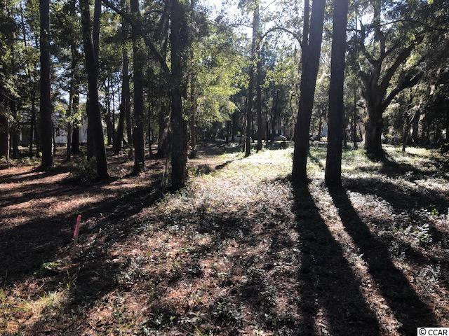 This lot is steps away from the marsh in a beautiful gated community.  It is on a quiet cul-de-sac next to existing dramatic homes with tremendous old oak trees. The community offers a pool area with a pool house, community marina with access to the Waccamaw river and a guest community home in Pawleys Island  on the ocean.The beach house gives the owner private beach parking with a well decorated home for restrooms and a great meeting place. The historic plantation house offers a special place for events and is highlighted by the magnificent approach by way of an avenue of hundred year old live oaks.
