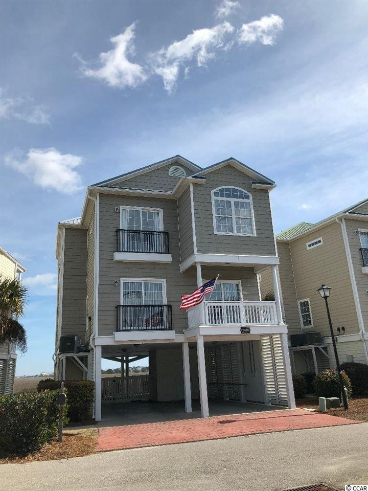 This beautiful direct marsh-front home in Cherry Grove is move-in ready With 9 ft ceilings and wide crown molding, it is a beautifully furnished, well-maintained raised beach house overlooking the marsh in quaint Cherry Grove Beach. There are plenty of spacious living areas and balconies galore, with five bedrooms and four full baths, this beach house will sleep 12, plus some! AND, it has its very own pool and elevator to make it enjoyable for everyone from the kids to the grandparents. Pointe Marsh also offers extra parking and it is within walking distance or a golf cart ride to the beach, shopping, restaurants, mini-golf, and more! You can even enjoy the fireworks out your breezy backdoors. Lawn maintenance included in the low HOA. Great place for a large family or would make a great beach rental.