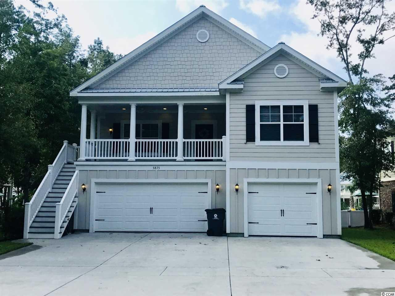 Beautiful two-story 4BR/3BA pool home within walking distance of the Marshwalk, public boat ramp, shopping and dining.  Unique features include a new salt-water pool with waterfall, 3-car garage, fenced-in backyard on community pond, first and second floor laundry rooms and propane tankless water heater.  No HOA fees.  Some furniture available if desired. First floor has two large guest bedrooms with large closets, 1 full bath, laundry room with large storage area.  3-car garage and driveway can hold 6 vehicles.  You can park your boat and/or RV in the driveway. Second floor has large master bedroom, master bath with garden tub, separate shower, huge walk-in closet with washer/dryer hook-ups.  Guest bedroom, another full bathroom, living room, breakfast nook and kitchen with stainless appliances and granite countertops/bar.  Attic access via master closet. Outdoor space has new salt-water pool with waterfall, fenced-in back yard on community pond, new sod, built-in gas grill, sink and small refrigerator.