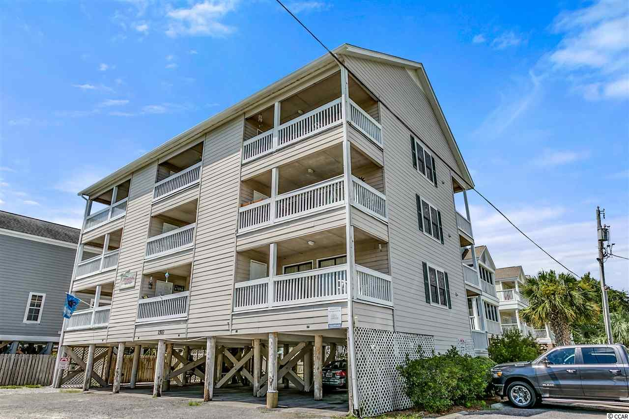 LOCATION, LOCATION, LOCATION! Open your front door and have your toes in the sand in under a minute! This fully furnished 2 bedroom, 1 bathroom condo also has a pool you can enjoy after a day at the beach! Low HOA which also covers insurance and cable. Don't wait- schedule a showing soon!