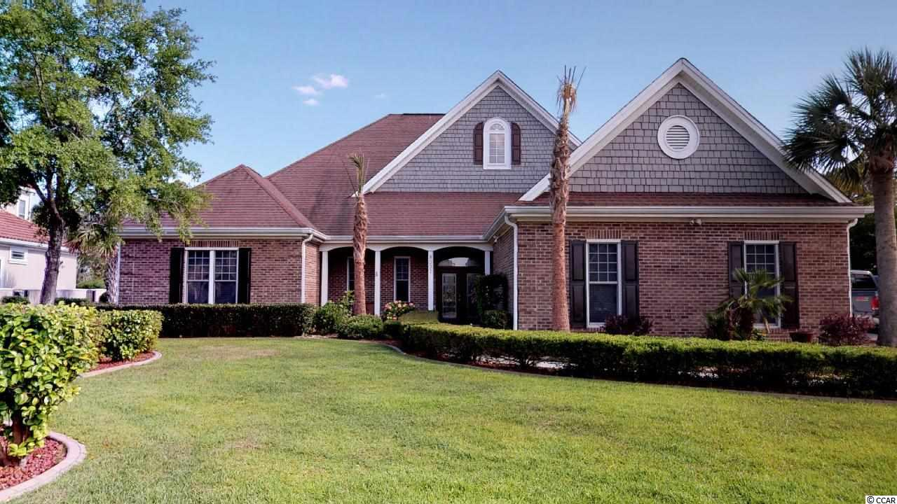 Custom built all brick 4 bedroom, 3.5 bath home on 0.93 acre lake lot in Plantation Lakes.  granite counter tops, large center island, large pantry, under cabinet lighting and breakfast nook. This light and bright home has a wall of windows looking out to the private backyard and lake; sun room has 4 doors that open to the outside, The Master Bedroom has tray ceilings, an extra large walk-in closet and French doors to outside. The Master Bath has a large shower with 2 shower heads and window. The fourth bedroom suite is located upstairs with its own bath and has a balcony that overlooks the lake. Some other features include stairs to floored attic storage, window shields, custom hurricane shutters and two attic fans, 3-car garage, beautiful landscape with a walkway to the lake, and a bulkhead to prevent erosion along the lake. Plantation Lakes provides resort living with a pool, clubhouse, tennis courts, fitness room, and boat docks. Just minutes to the beach and shopping, medical facilities, and schools.