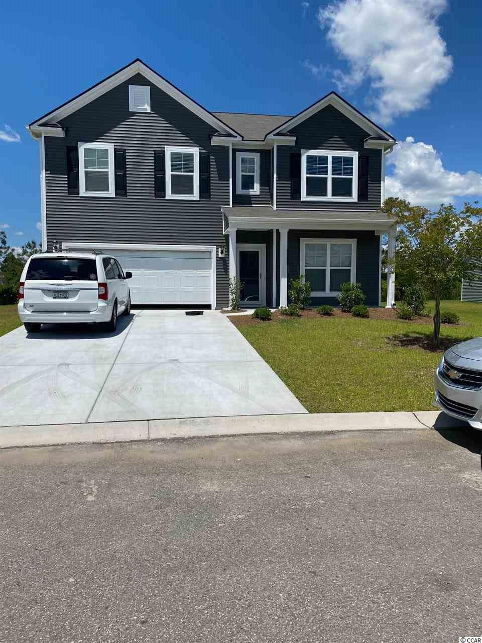 The Hampton is a wonderfully flexible plan with a large lower level bedroom and bath perfect as an in-law suite. The open kitchen features a large center island with breakfast bar for quick, casual meals. Screened in porch with wetland/private views on a fantastic home site.  Photos are of similar floorplan   Come see all that Heritage Preserve has to offer!