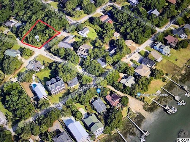 LOOKING TO BUILD YOUR FOREVER HOME? Beautiful corner lot available only one block from the waters of Beautiful Murrells Inlet. This lot is in a peaceful tree covered community with a boat ramp just a block away for you to use freely. Just a short drive from all that Murrells Inlet has to offer and the popular Marshwalk restaurants & shops!
