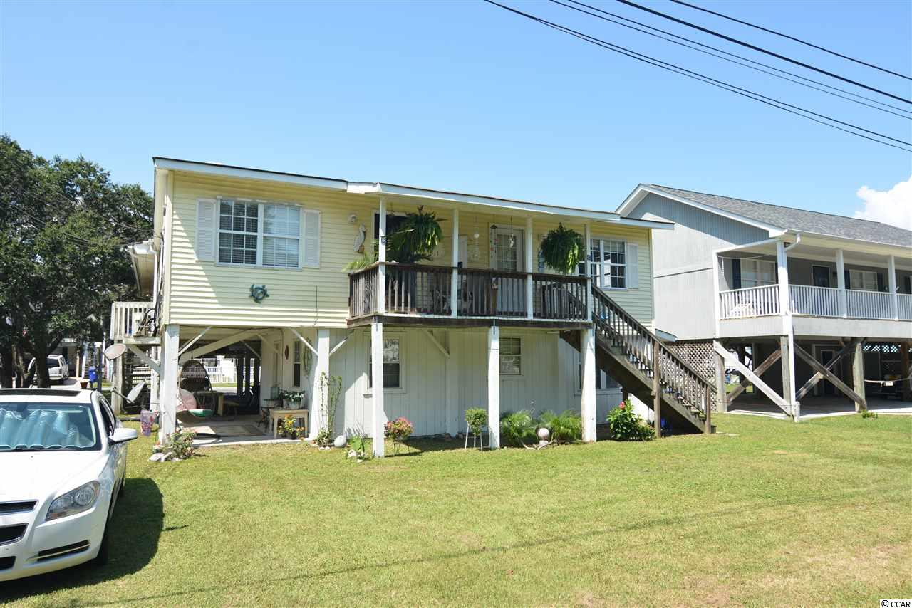 The Perfect Investment Property - Only 2 Blocks to the Beach! Long-term AND Short-term Rental allowed.  Raised beach house includes a 4bd/2ba unit as well as 3 other 1bd/1ba units on the other side w/ community laundry facility in the building. Live in one side and rent the others - Steady rental revenue year round! Easy golf cart ride to the 2nd Ave beach entry and all of the Surfside Beach and Garden City shops, restaurants, grocery stores, amusement rides, farmers' markets, and much more! Surfside Beach is just a short drive to everything Myrtle Beach has to offer including Coastal Grande Mall, Tanger Outlets, marinas, public docks, landings, restaurants, golf courses, shops, entertainment, MyrtleBeach International Airport, Broadway At The Beach, The Market Common, Barefoot Resort and Coast Carolina University (CCU). Also,only 90 miles to beautiful Charleston, SC.