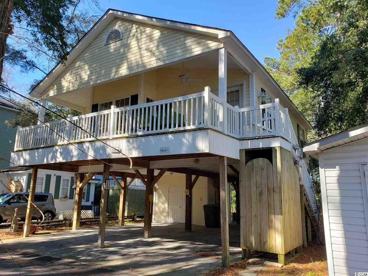 This charming and lovingly maintained beach home is located in Ocean Lakes Campground which is located on 310 acres of oceanfront property. This  an all season vacation campground with all season activities.   Everything you could possiby need or want to do are within the grounds! From your very own waterpark, indoor pool (heated in winter) mini golf, basketball court, volleyball, golf cart and bicycle rentals, cafe, grocery store to 19 beach access points the list goes on and on. This 800 square foot open floor plan makes this home absolutely comfy and cozy and a vacationers dream come true. 3 bedroom, 2 full bath, kitchen, dining, living area, laundry with stackable washer & dryer that is included, spacious front porch, 2 car parking underneath, outdoor shower, large double door storage room is large enough for parking your golf cart. The entry stairs were newly constructed in September of 2019. You will be nestled on a private road with a wooded view from your large front porch yet moments from beach, amenities , dining, shopping and more! Town is golf cart friendly. A perfect 2nd, permanent , vacation, rental or investment property. This is a one owner home.  The opportunities for this one are endless! This home comes fully furnished. Call for your showing today!