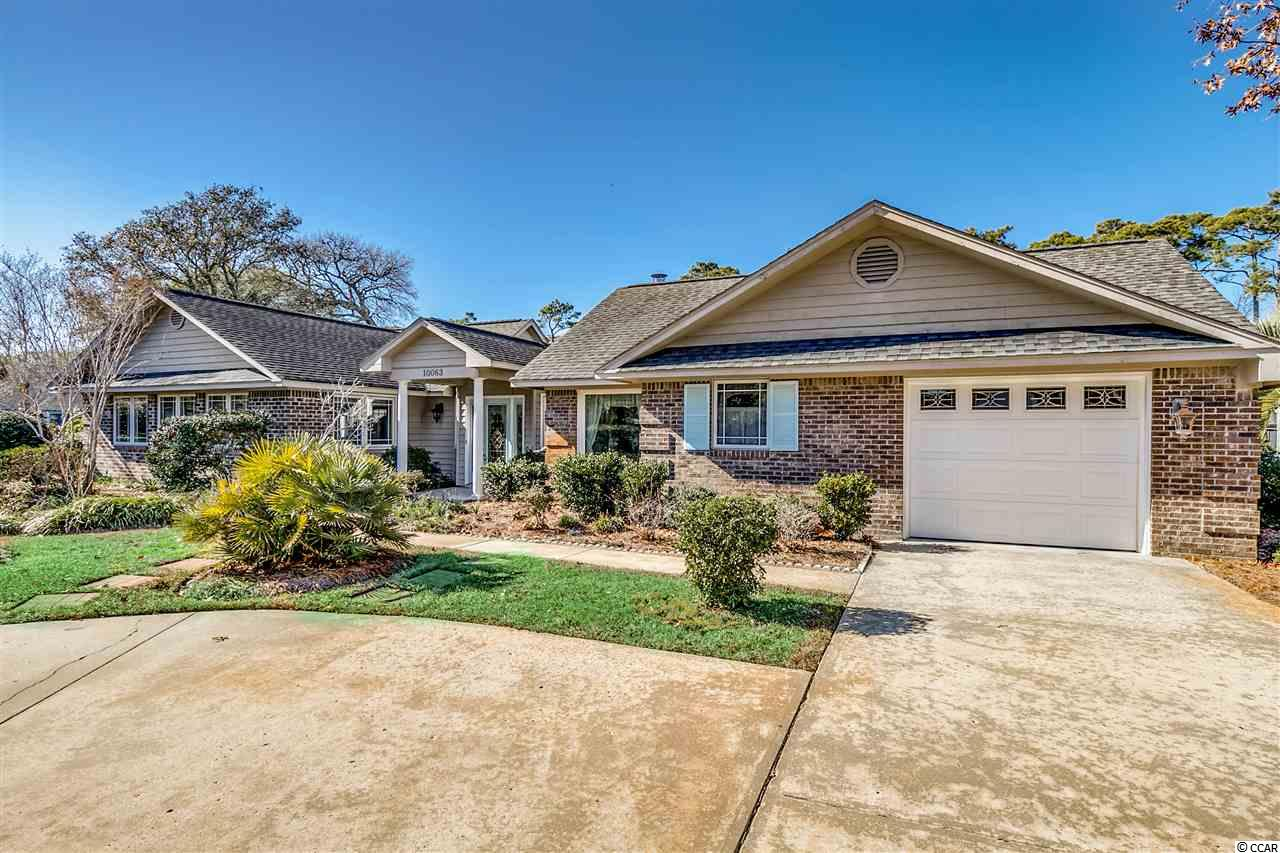This stunning 3 bedroom 3 bath home is not one to miss!  It's located walking distance to the beach and close to some of the best shopping at the Tanger Outlets- or grab dinner at nearby restaurant row!  The original home was added onto in 2005 expanding it to 2370 heated square feet of upscale living!  Gorgeous porcelain wood looking tile expands the main living area and all three bedrooms- enjoy not one but TWO fireplaces- a wood burning one in the dining room and a gas fireplace in the family/great room.  The kitchen features granite countertops with a shell coral countertop on the breakfast bar, beautiful tile backsplash, and instant hot/cold filtered water upgrade.  There is currently an electric stove but gas is available if a gas stove is preferred.  The large 12X24 master bedroom has plenty of space for a bedroom set and a sitting area- vaulted ceilings, 2 ceiling fans, and a spacious walk in closet- the ensuite master bathroom has comfort height double sinks, dual shower heads, 2 linen closets, and a sky light to allow plenty of natural sunlight in.  Or step out of the master bedroom through the sliders onto your pool deck!  That's right- this home has a 12X25 saltwater pool!  The saltwater pool generates it's own chlorine and has the components for a heater to be installed if wanted.  It has a waterfall feature and two water jet areas.  Come back inside through the sliders to the family room where you'll notice the high vaulted ceilings with two skylights.  The Carolina room is located off the family room and has it's own full bathroom- could easily be used as another bedroom if desired.  There is also a large wood deck in the pool/courtyard area.  Some other features of this home are a one car garage as well as a golf cart garage with shelving, irrigation on the front/side yards, HVAC's are 2014 and 2019 and have the HALO air filter systems, roof is 2005, freshly painted fencing... the list goes on.  Same owner since the day it was built and it has been t