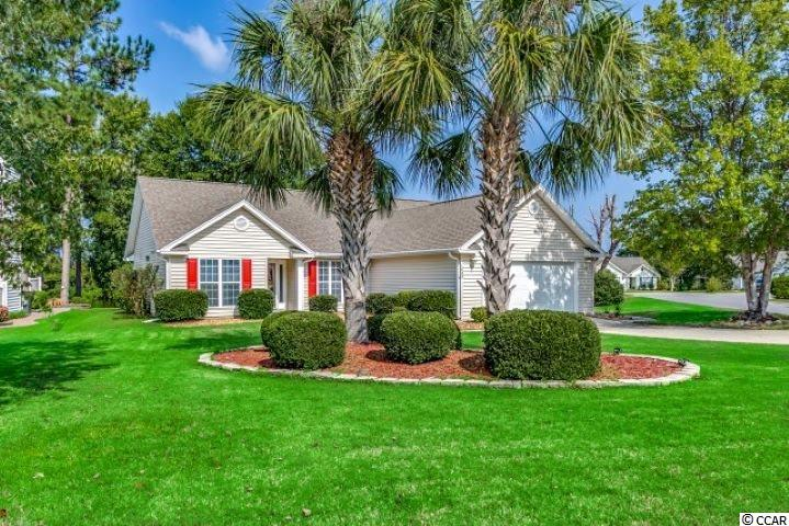 Ultimate in coastal living - this absolutely charming lakefront 3BR/2BTH home offers one level living and is located in a well established South Strand neighborhood and only a 1 mile golf cart ride to the beach. Situated on the corner of a quiet cul-de-sac, this well-designed split bedroom plan overlooks a natural lake in a wooded surround - what a view! Professionally landscaped with accent borders and river rock, flowering beds and palm trees maintained by an irrigation system. Exterior of home has low maintenance vinyl siding with a decorative front storm door, double attached garage with a side entry door, mop sink, new door opener and gutters and pull down stairs with floored attic storage. (Both roof and HVAC were replaced in 2016.) Interior features vaulted ceilings and plant shelves in living room and kitchen, freshly painted with new carpeting throughout main living areas, upgraded lighting fixtures and fans and new raised vanities in both baths. Galley kitchen has a breakfast nook with bay window, ceramic tile flooring, cabinets have been resurfaced complete with Corian counters and includes a pantry closet. All kitchen appliances included (brand new microwave). Separate tiled laundry room off kitchen includes washer and dryer with pedestals too. Huge 12' x 17+'sunny Carolina room entering from the spacious living room has lots of windows with a view of the lake, two 6' sliders on sides with separate patios including another on the rear for grilling and relaxing, vaulted ceilings and custom blinds. Private en suite includes a large master bedroom with vaulted ceiling with lighted fan, walk in closet, separate commode room, extended raised vanity with double bowl sinks and decorative mirrors, oversized walk-in tile shower with hand held shower controls, a built in linen closet and ceramic tile flooring. (Some furniture available for sale separately.) Amenities include a community pool and cabana overlooking a natural lake. Centrally located, Ashton Glenn is just a short drive to shopping, golf courses, entertainment venues, tons of restaurants, health facilities, Myrtle Beach airport, beaches, boat landing and waterway. Square footage is approximate and not guaranteed, buyer is responsible for verification.