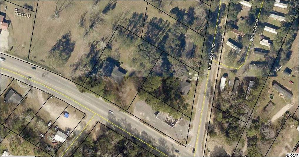Corner Lot at Traffic Light on Highmarket Street (Hwy 521) and McDonald Road. Zoned General Commercial and consists of 3 Lots. Total Acreage of 2.24 Acres. Corner Lot is TMS #02-0211-062-02-00 and is the former Palmetto Kitchen Restaurant of 2502 sq ft. Residential Home is located behind that site at 47 McDonald Road of TMS #02-0211-065-00-00 of 2527 sq ft. Residential Home is located at 3378 Highmarket Street of TMS #02-0211-063-00-00 of 3317 sq ft. Great use for an Investor to Build on Corner Lot or Remodel Homes and Rent. Located in Close Proximity to Georgetown County Schools, County Fire Station and Gene's Country Store.