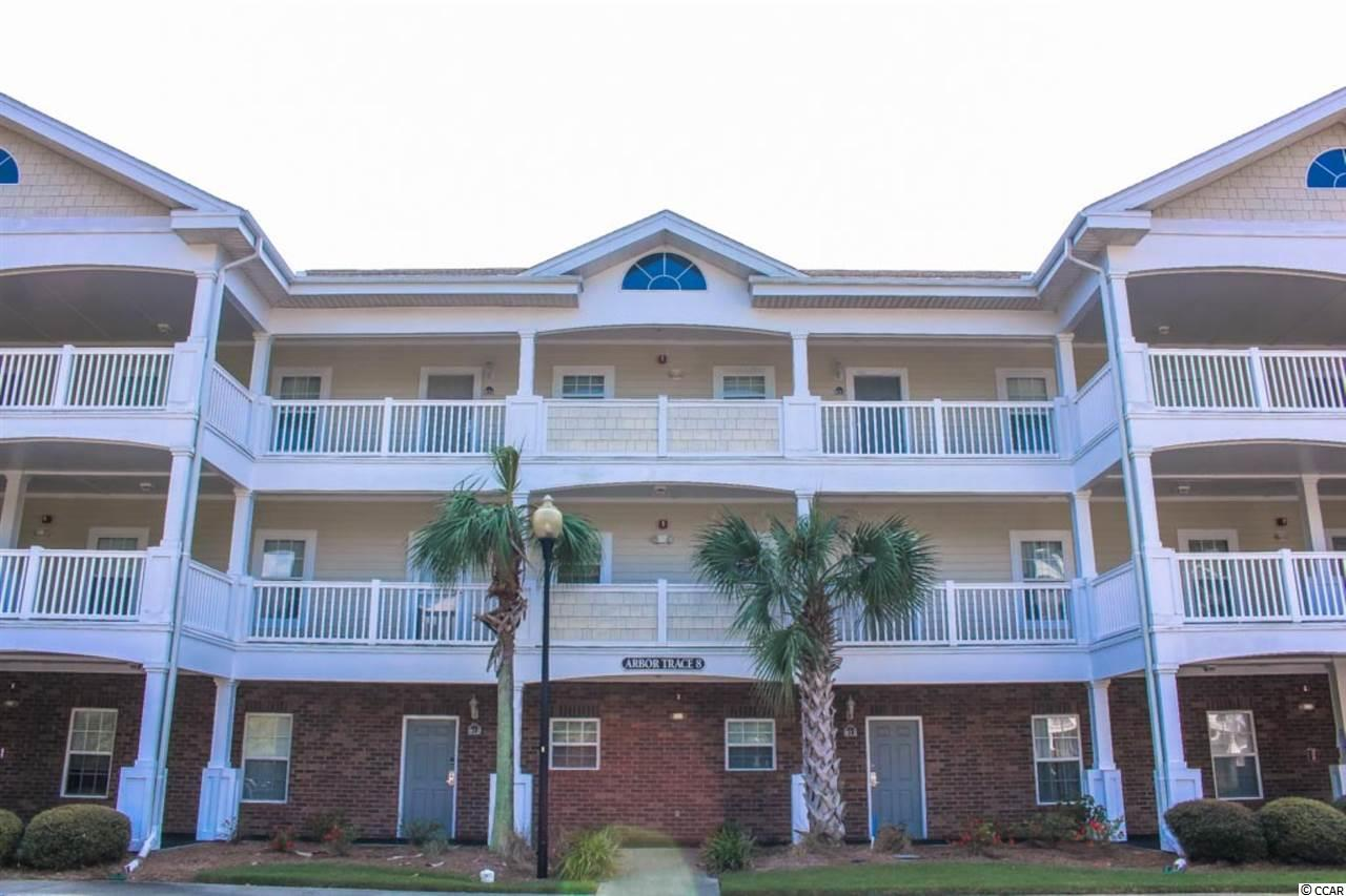 Must see 2br/2ba, 2nd floor, golf villa in Arbor Trace within Barefoot Resort! This unit has a large kitchen upon entrance that overlooks a dining area, living area and a large screened balcony with views of the trees and the golf course beyond. The master suite is well appointed with 2 closets and on suite bath. The 2nd bedroom in this split bedroom layout is at the front of the unit just off the foyer with the 2nd bathroom right outside for convenience. This condo also has a 1st floor storage unit at a yearly fee, which is a great feature for storing beach chairs and umbrella. Arbor Trace has a community pool and beautiful grounds that include walking trails.  On top of this fantastic golf villa, Barefoot Resort is a 2300 acre with all of the communities and golf courses. It has so much to offer including 4 championship golf courses with 2 multi-million dollar club houses, a driving range w/ an adjacent Bar & Grill, Greg Norman Golf Academy, a private beach cabana w/seasonal shuttle service to/from the ocean, a 15,000 sq ft salt water pool on the ICW, full service marina, walking trails, restaurants and so much more! Barefoot resort is only a mile from the ocean and right across the bridge of Barefoot Landing, where a multi-million dollar renovation is adding numerous upscale dining, shopping and entertainment year round.  The location of the unit gives you the added opportunity to experience other attractions in Myrtle Beach, Little River and Cherry Grove.