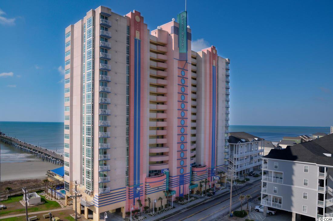 Live like royalty in the newly updated Prince Resort unit 1808. Towering high above the sun-kissed shore, this opulent, two-bed, two-bath, oceanfront masterpiece offers one of the most breathtaking views in all of South Carolina. Floor to ceiling windows and a warm coastal color scheme welcome you as you step through the door. The chic, full-size kitchen comes complete with new beautiful granite counter-tops. New HVAC system was installed in 2018 and new laminate flooring was installed in 2019. From the over sized private, oceanfront balcony, enjoy a stunning East Coast sunrise while also enjoying your morning coffee or tea.  Amenities abound at the magnificent Prince Resort, including outdoor pool, two hot tub, kiddie pool with waterfall, and restaurant. Phase II across the street has a rooftop pool, lazy river and two hot tubs with beautiful ocean views, state of the art fitness room overlooking the Cherry Grove marsh with weight and cardio equipment. Best of all, take just a few steps onto the beach and you'll find yourself at the famous Cherry Grove Pier.   Whether you are looking for the ultimate investment property or a cozy coastal hideaway for those cold winter months, Prince Resort 1808 is the perfect condo for you!