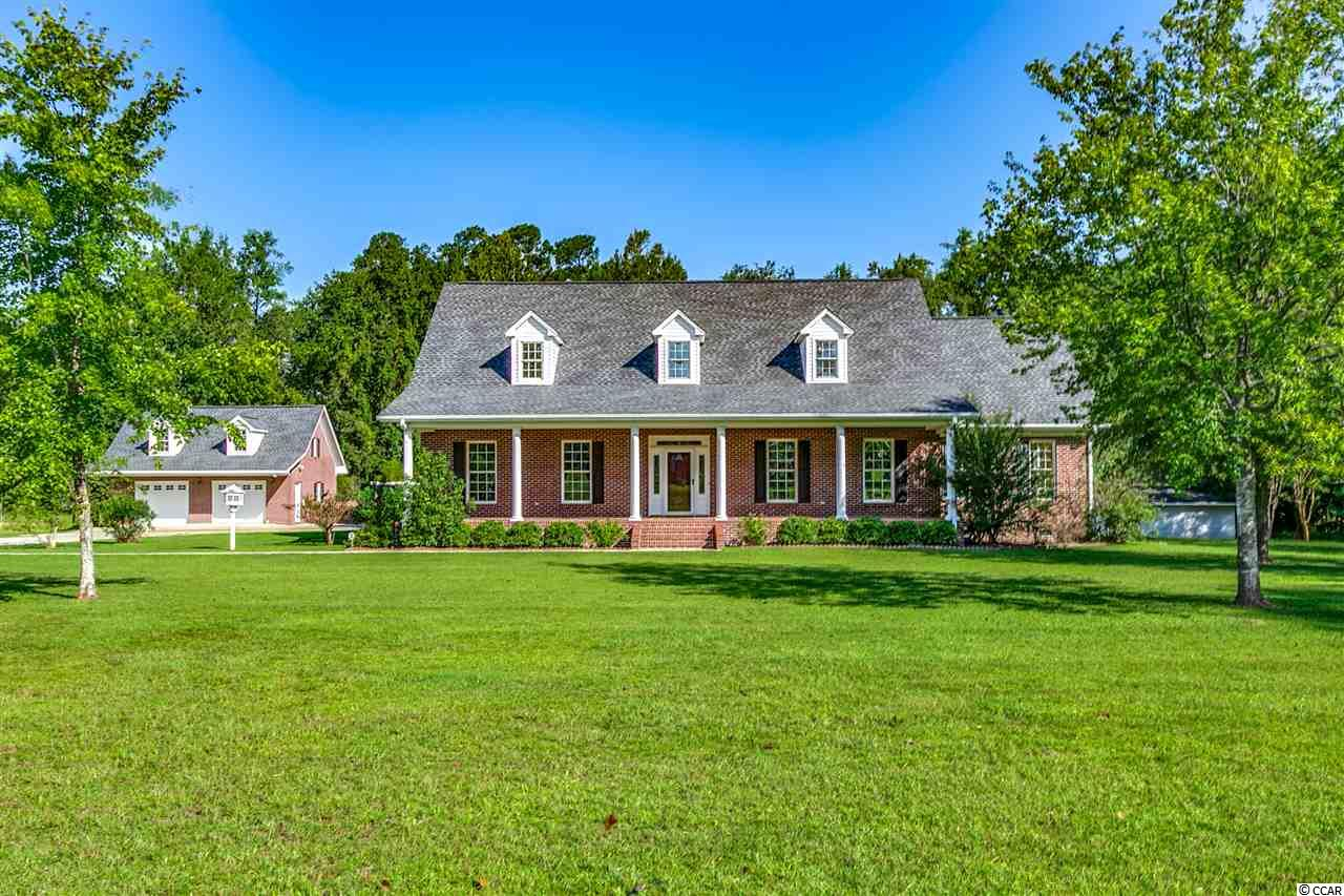 "Home is being sold ""AS-IS"". All brick 5 BR, 3 1/2 BA home that sits on 6.97 Acres with s small pond on the property. 2-car detached garage with power. Pool house has a full kitchen with a 1/2 bath. This home has a lot to offer, from formal living and dining area, a great  room with built-ins and a fireplace, a breakfast nook,  a office/playroom, spacious bedrooms with the Master Bedroom/Bath being downstairs, a bonus room over the garage, lots of storage space and so much more."