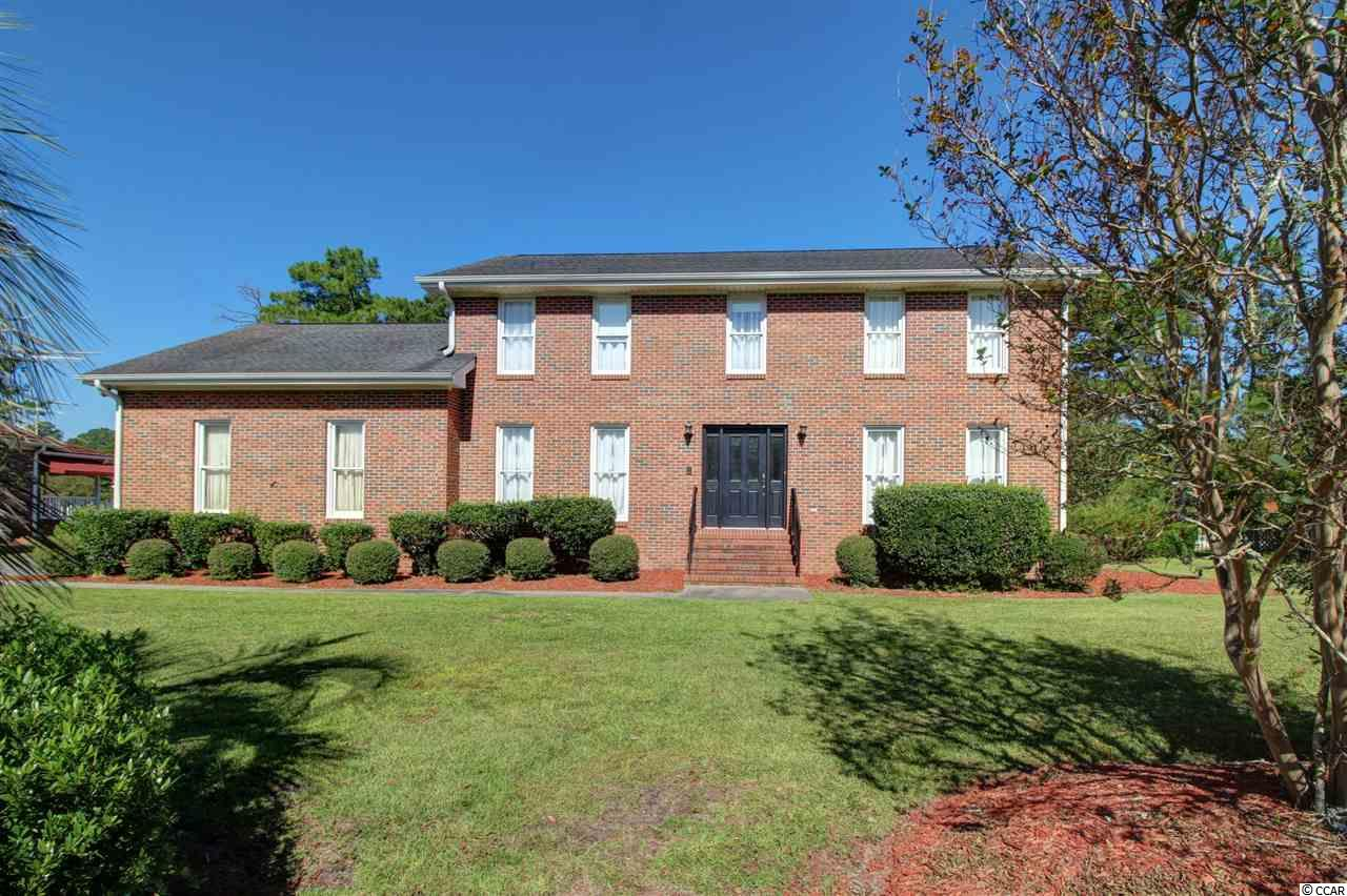 You'll love this beautiful, all brick true 4 bedroom, 3 bath home located just 5 miles to downtown Conway and 10 miles to Myrtle Beach. The home overlooks The Hackler Golf Course in Coastal Heights! The kitchen has a breakfast nook, lots of cabinets, silestone counter tops and stainless steel appliances. Entertain in the formal dining and living room or enjoy the den with a built in shelves and a brick fireplace.  Upstairs you'll find 4 bedrooms, 2 bathrooms plus a large bonus room. There is also a bathroom with a shower on the first floor at the bottom of the second set of stairs that's in the kitchen. The home has fresh paint and new carpet as well. Relax and enjoy peaceful living in the private, covered back deck overlooking a spacious backyard and the golf course. This well-kept community has NO HOA and is close to Coastal Carolina University, Tanger Outlets, shopping, restaurants, and all the Conway/Myrtle Beach has to offer.