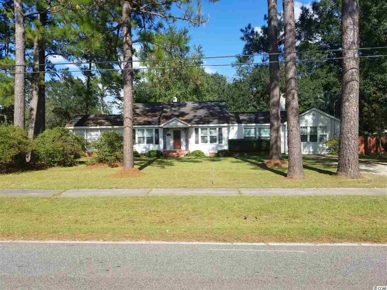Spacious home with beautiful hardwood floors.  Carolina room with fireplace and tile floor.  Office with fireplace, hardwood floor and knotty pine paneling and ceiling.  Formal dining room and separate breakfast room.  Large deck overlooking beautiful side yard.