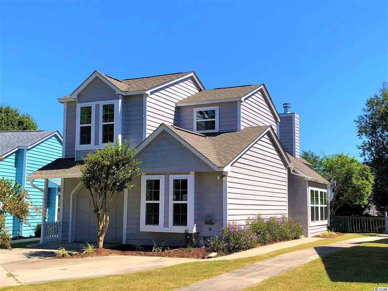 "CUTE AS A ""BUTTON"" is this 3 Bedroom, 2 Bath, 1 1/2 story home in the very desirable area of ""Lake Homes @ Belle Park"".  Master Bedroom is on the main level. In the heart of North Myrtle Beach just minutes to the beach, the Inter-coastal Waterway, Grand Strand ER, Restaurants, Post Office, and Shopping.  This home has been remodeled and is ""like new"".  Enter the large Great Room with Vaulted Ceilings, New Fireplace, and a display of light from the  bounteous row of windows overlooking the pond and pond bridge to the Pool.  Enjoy the pond fountain from the Den, also circled with windows. This Charmer boasts in 2019:  NEW ROOF, NEW WINDOWS, NEW WATER HEATER, NEW REFRIGERATOR, NEW CHIMNEY, NEW FIREPLACE, NEW KITCHEN CABINETS, NEW GRANITE COUNTER-TOPS, NEW KITCHEN SINK, NEW MICROWAVE/RANGE HOOD, NEW CEILING FANS, New Mantel and Trim, New Paint (interior).  New Bathroom: Vanities, Sinks, Toilets, Faucets, Mirrors.  New Kitchen Faucet, New Bathroom Tile upstairs,  New Light Fixtures throughout (inside and outside), New Door Hardware and Locks throughout, New Outlets and Cover Plates throughout, New A/C Registers, New Garage Door Sensors, and updated Landscaping.  In 2018 New Carpet.   In 2016: NEW HVAC, NEW DISHWASHER.   HOA includes: Lawn service, Pool.  DO NOT WAIT ON THIS ONE!"