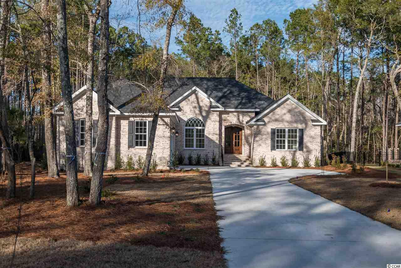 Custom New Construction in The Reserve! Take your golf cart to the Greg Norman golf course, the marina, the beach, the grocery store, or one of the many restaurants connected by cart path to the Reserve.  The Reserve is a beautiful, tranquil, gated community with abundant amenities including private beach access through Litchfield By The Sea, a Marina on the Waccamaw River with wet and dry boat slips, and large community pool.  This all brick, 4 bedroom, 3 bath single-level home features open concept living spaces, while maintaining privacy and separation for the master suite.  Entertain with ease in the stunningly-upgraded chef's kitchen which looks onto the large screened porch with gorgeous brick gas fireplace.  The open living area features massive built-ins flanking a dramatic fireplace.  Designer features and finishes abound, including a Rinnai tankless water heater, custom tile, wood, and cabinetry throughout.  An oversized, two-car garage features extra space for your golf cart.  View this custom builder's recently completed projects upon request.