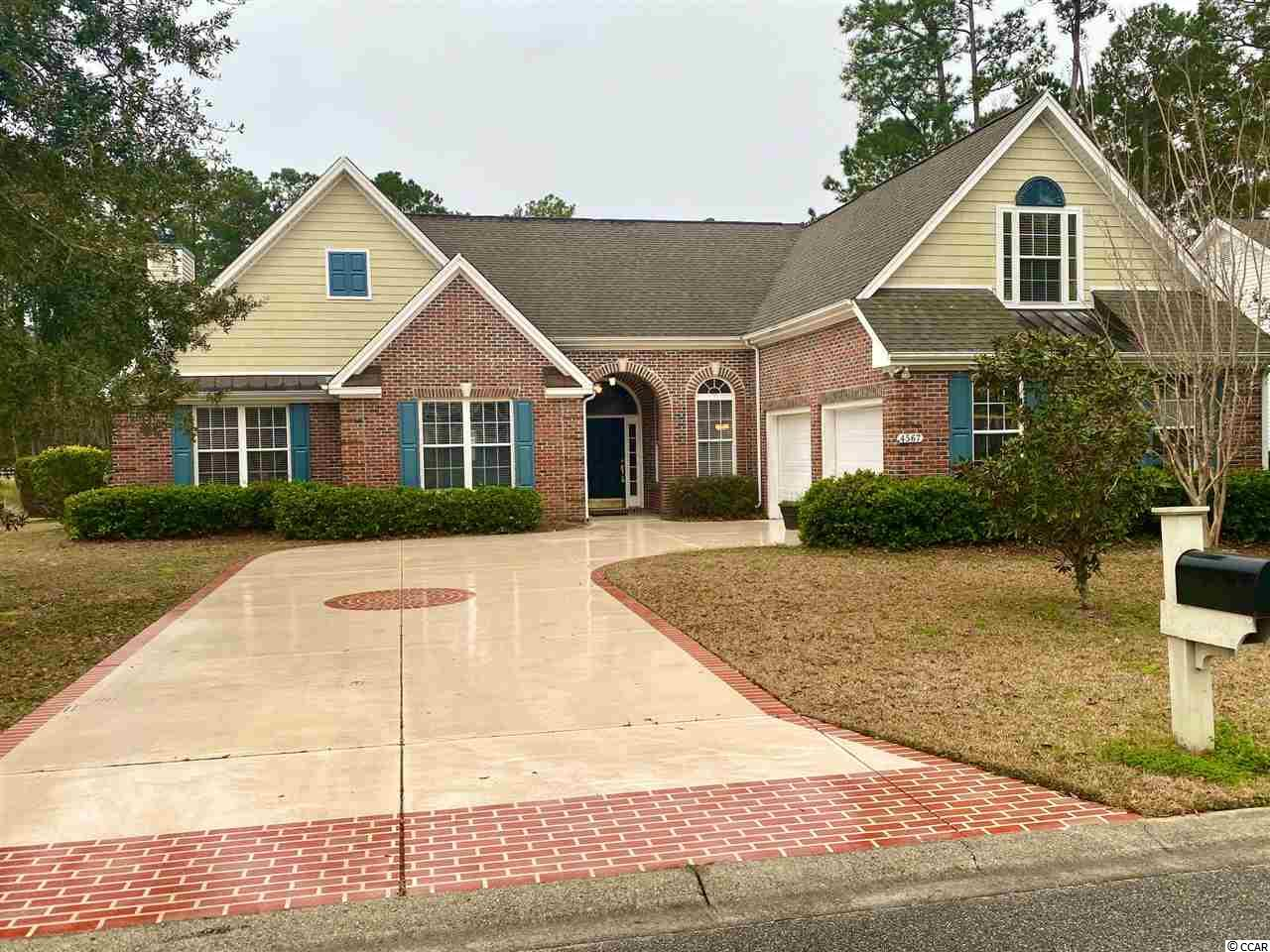 You will love this Gorgeous Brick home in Murrells Inlet with 4 large bedrooms and 3.5 Bathrooms. Located on the golf course in an executive section in Wachesaw Plantation East. The family room has vaulted ceilings and a fireplace that spills into the Carolina Room with breathtaking lake and fairway views. The large open kitchen with breakfast nook, work island, granite countertops and stainless appliances is open to the family room.  The formal dining room is accented by beautiful moldings and trey ceilings. The huge master suite is tucked away on its own wing and has its own fireplace, sitting area and private covered patio. The master bath is perfectly appointed with a large walk in closet, a private water closet, double vanities, a deep soaking tub and a walk-in shower. Wachesaw East offers a wide variety of exclusive amenities, a community pool, tennis courts, a clubhouse with an exercise room. You will be in awe walking through the beautiful trails of this gorgeous treelined community with outdoor work out stations, 24 hour gated guarded security and the gorgeous 18 hole signature golf course. The Waccawachee Boat Ramp and Marina is just down the street from the back gate. Close to Tidelands Hospital, Restaurants, shops and world class entertainment in the Murrells Inlet Marshwalk!