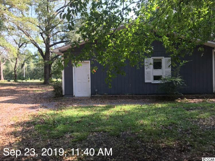 This property is located within minutes of Georgetown's city center and its shopping and dining venues. To the north are Pawley's Island, Litchfield Beach, Murrells Inlet and Myrtle Beach all with in 40 minutes. To the south is Mt Pleasant and Charleston. This lot does back up to the Black River and the boat landing for Peters Creek, a deep water creek, is close by. This is a 1 acre lot on the river, use this tiny home while you build your dream home!
