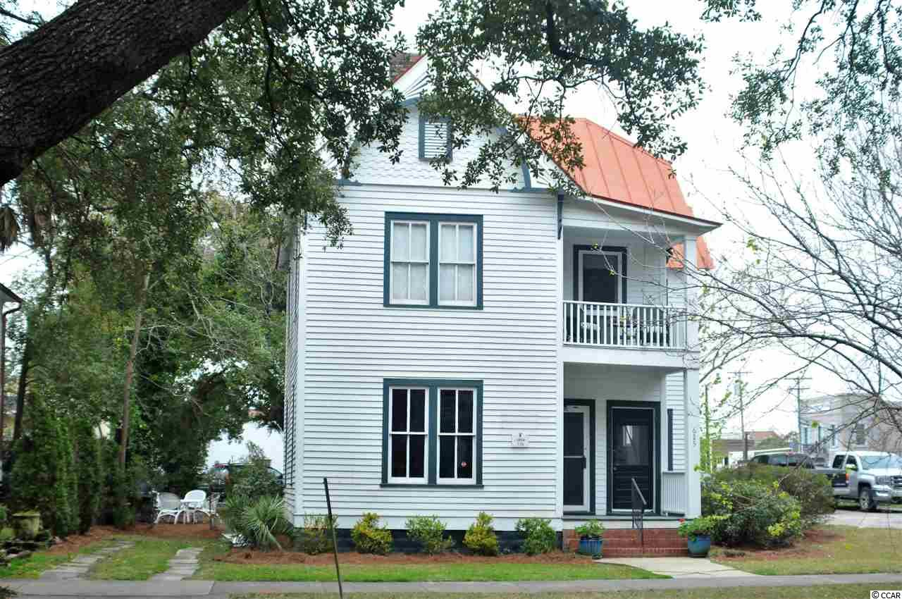 """Welcome to 625 Prince Street.  This charming late Victorian row house sits in the heart of the historic port of Georgetown, just one block from the riverfront museums, restaurants, marinas, and shopping.  Built by local entrepreneur Mark Moses in 1894 as part of four similar """"sister"""" houses (617-627 Prince), this 2500 sq ft dwelling was converted into a duplex by the current owner in 1978.  The entire house has turn-of-the-century hardwood floors, high ceilings, and large windows characteristic of the period. The bottom floor served as a law office for many years and is now ready for renovation.  The top floor is gorgeous: 2 bedrooms/1 bath, recently remodeled with all new appliances and a new kitchen.  There are separate entrances for both floors at the front and rear, plus a two-story porch.  625 Prince is now residential income property, with the potential to be used for light commercial, or to be easily reconverted to a single-family house.  This exceptional property is located in the heart of the Georgetown's historic district, a large walkable area of sidewalks shaded by live oaks separating them from the street. Located just 45 minutes south of Myrtle Beach and 80 minutes from Charleston, Georgetown was recently voted USA Today's best small coastal city in America."""