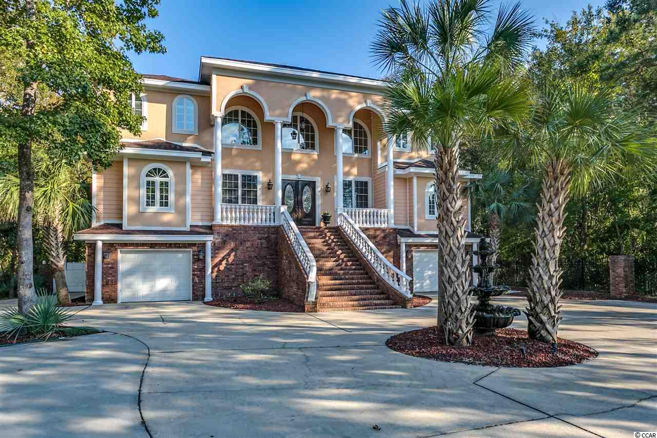 Located in the Waccamaw Lakes section of North Litchfield Beach, this custom built home offers over 5000+ livable sq.ft.  This home features 6 bedrooms, 6 full bathrooms & 1 half bath.  This spacious home offers flexible floor plan with a space on the ground level that can be utilized as a mother-in- law suite.  Exterior boasts a secluded back yard with private pool and covered lounge area with the feel of an island oasis.  The porches are great for outdoor entertaining plus a basketball goal in the driveway for some healthy, family competition.  Conveniently located with pristine white sand beaches of Pawleys Island.