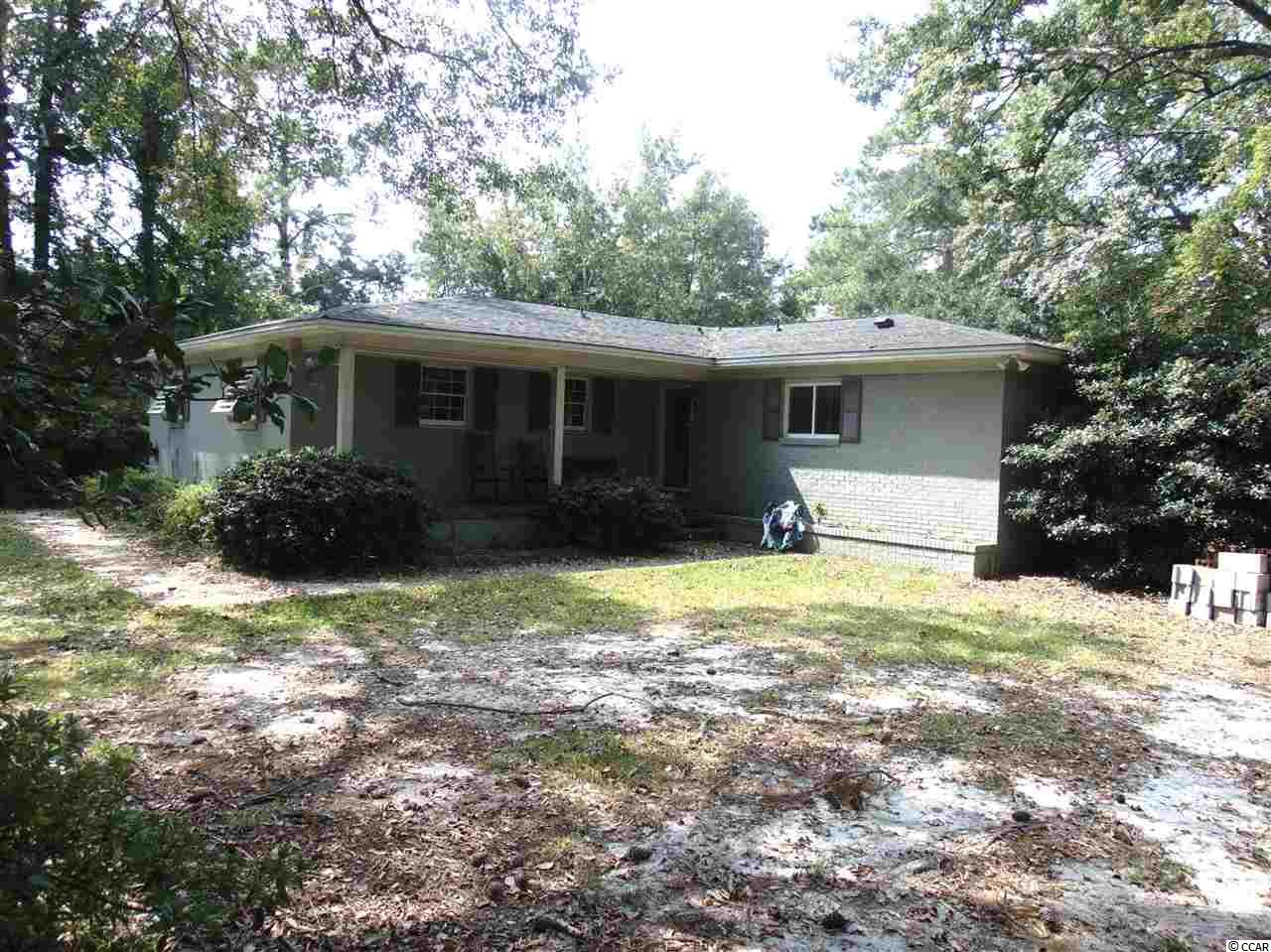 TOTALLY REMODELED AND UPDATED HOME IN THE OCEAN DRIVE SECTION LARGE 2/3 ACRE WOODED LOT. VERY PRIVATE. LOCATED ON THE 6TH GREEN OF THE SURF CLUB GREAT VIEW WITH WATER ON 2 SIDES.  OUTDOOR KITCHEN AND ENTERTAINING SPACE. CREATED BY CONTRACTOR AND ARTIST