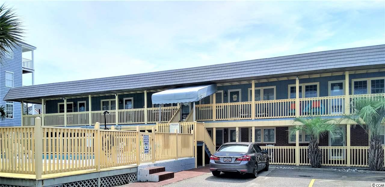 A rare opportunity to own a great first floor fully furnished corner unit in the very desirable Cherry Grove section of the beach. Largest condo in this complex. Enjoy the wonderful atmosphere of a small community, while only a stone's throw from the ocean and a beautiful wide beach. With a total of only 20 units, it carries a simply unforgettable beach charm. Meticulously maintained, this property has very low monthly HOA (which includes insurance, cable, etc..) and makes a perfect second home or rental. Open floor plan, fully remodeled kitchen with brand new appliances, completely remodeled bathroom, brand new hardwood floors and tile, new HVAC with a remote control, new high efficiency Bosch washer and dryer make this condo truly standout even to the most discerning buyer. Condo is sold fully furnished, including electronics. It's time to get away from all the hustle and bustle and make some wonderful memories here at the beach! Come see it today!