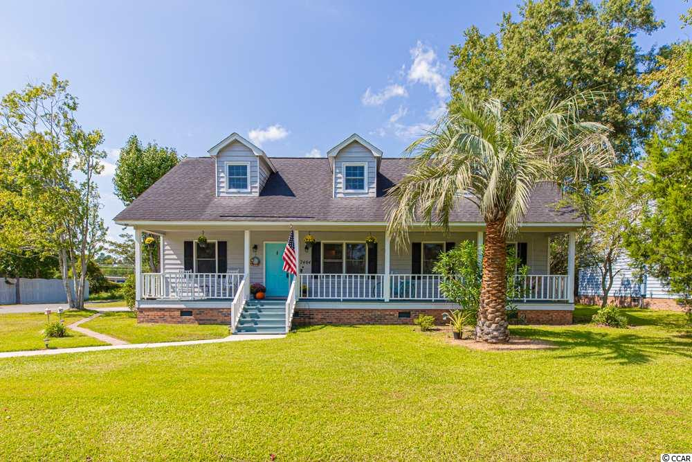 REDUCED!! Brand NEW installations in 2019 include a new roof, outdoor fence, new 2nd story windows, new Luxury Vinyl flooring and garage condenser/ air handler. New in 2018 include Main house HVAC (condenser, air handler runs and duct replaced) and 2 Bipolar air purifiers in main house. new in 2017 include Pool liner/ Salt water system! A beautiful Fully upgraded kitchen and appliances were installed in 2014! The converted garage with its own HVAC system still has original barn style doors on the house. Garage can easily can be converted back into a functioning garage.  If you are looking for that picturesque home close to the beach with front-porch swinging, and your very own in-ground saltwater pool, look no further! This beautiful Low-Country style home is where Real Living Begins! Move-in ready home has been freshly painted, and features TWO master bedrooms, a main level master suite and a separate second story master suite. Your fully upgraded kitchen is ready for your home cooked meals surrounded by friends and family. Sit around your own gorgeous wood-burning fireplace in the cool winter months. Your home will undoubtedly be THE place to be! The 2nd story suite is transcended by flex loft space, that can be used for a media room, home office, or whatever your heart desires. The possibilities are endless! This home features 3 bedrooms but currently being shown as a  4th bedroom using an very large walk in closet. .As if one bonus space wasn't exciting enough, enjoy a main level bonus space and the large garage that has been converted into a recreation space looking out onto your very own beautiful in-ground saltwater pool.  Owners have a security system that is disabled but new owner can reactivate. This home has everything you need for total happiness and enjoyment for the whole family. Home can also be used as a mother in law suite! Independent Appraisal and Inspection have already been done, this home is ready. Are you?