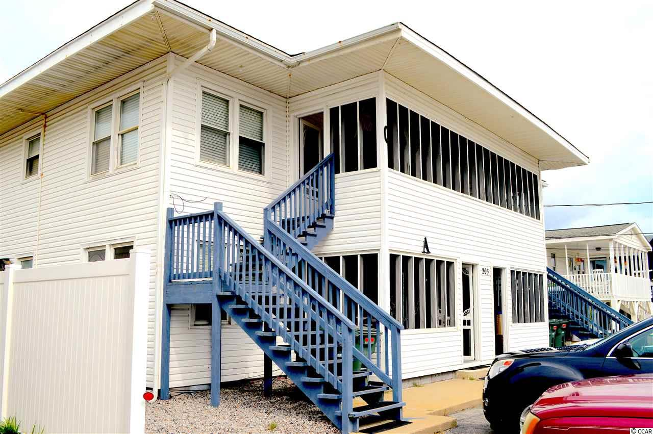 MONEY MAKER!!! This quadraplex is just steps from the beach has been refurbished and rents like a charm.  Each unit features stove, refrigerator, dishwasher, washer and dryer and all but one unit comes partially furnished.  Building is in great shape and is easy to maintain.