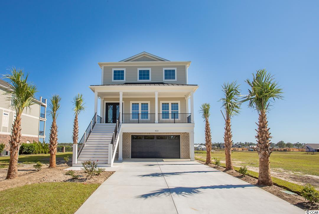 """A truly one of a kind direct Intracoastal Waterway home located in the gated community The Battery on the Waterway. This location puts you close to everything the area has to offer. This home has an exclusive list of features and upgrades that may not be visible from websites so please ask your agent for a detailed features list. The backyard includes a beautiful 180-degree view of the waterway, a resort style heated 38'x24' infinity edge concrete salt water pool with 8' spill over hot tub, travertine paver decking, and granite outdoor kitchen and bar area. Down the steps from the pool is a fully fenced yard perfect for pets and kids. The waterway area has been dredged and a dock permit is in place for immediate build of your own private dock and boatlift.  The ground floor features a heated and cooled, fully insulated 2.5 car garage with epoxy coated floor.  Walking inside from the garage you will find teak engineered wood flooring, a kitchen, living area, guest bedroom, along with a full bath and laundry facilities, giving you the flexibility to use this for family living, guest space, or an in-law-suite. The second-floor features ¾"""" solid hardwood teak flooring, a welcoming 8'x6' iron front door, and a 12' wide sliding door to the main 28'x12' covered deck with spiral staircase down to the pool area. While enjoying the view of the waterway you can spend time in the dining room with crystal chandelier, the living area with coffered ceilings and floor to ceiling tile, 5' linear vent less built in gas fireplace, or enjoy cooking in your very large gourmet kitchen.  Kitchen features include Calcutta quartz counters, waterfall edged 8' island with sink and 150 can beverage fridge, 42"""" upper cabinets with 15"""" lighted glass door cabinets above, high-end stainless-steel appliances including dishwasher, 48"""" stainless dual fuel double oven/range, microwave, and a 66"""" wide fridge/freezer.  Steps away is your very large pantry with teak butcher block counters.  To finish off"""
