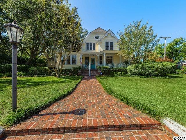 This home is on the historic Registry and is truly a one of a kind! Built in 1910 and remodeled with its historic integrity intact. The main house Features a master bedroom on the first floor. The multiple chandeliers, fireplaces, and outdoor living area just bring the charm alive. This is Southern hospitality at its finest. There is also a large guest house, detached garage, and detached storage featuring electricity and water. A Virtual tour is now available. Call today for more details!