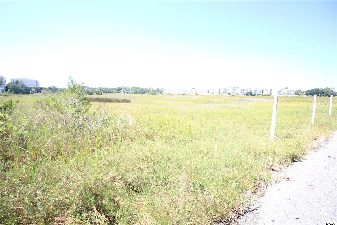Build your dream Cherry Grove beach home on this lot with incredible marsh views.  You will own the land next to you so no one can build beside you and compromise the view.  This lot is located in the 400 block of Cherry Grove, just a couple blocks from the beach.  Cherry Grove Beach is popular for its laid back beach lifestyle, the pier, public docks on the marsh and shopping nearby.