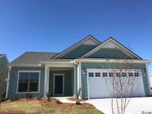 Martin Ray Floorplan with 3-bedroom/2-Bath, Library, Screened Lanai with Cascading Glass Slider doors. Large Master Bedroom with Tray Ceiling, Fully Tiled Huge Walk-in Master Shower, Walk-in Master Closet. Natural gas community, 2-car garage.  Water view homesite.