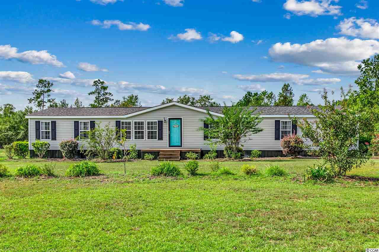 Are you looking for country living at its best? This is it!! This beautiful, spacious manufactured home is situated on 4.51 acres. This 4 bedroom, 2 bathroom home has a new roof and all new luxury vinyl tile throughout the house. Also, all new storm windows, upgraded wide baseboards and crown molding. This home also has custom built cabinetry in the kitchen. The bathrooms have new cabinets with granite countertops. Fresh paint throughout the house.   The large master bedroom opens up to a large bathroom with a jetted tub. There is a large walk-in closet. There is also a room off the master bedroom  that you can use as a nursery, office, or hobby room.   *You don't want to miss this*  The HVAC system is only 7 years old with warranty remaining. The duct work has been replaced. The water heater was replaced in 2018.  There is a 40 x 60, 3 stall shop on the property with electricity and water.   *This home did not flood during any of the latest major floods*