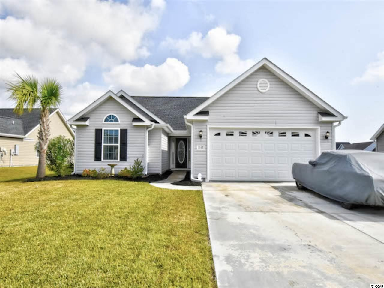Welcome home to this spacious 3 bed, 2 bath home with a lake view in the Mallard Landing Park community of Surfside Beach! This home features an open floor plan with vaulted ceiling and luxury vinyl plank flooring. The kitchen offers ample granite countertops and matching tile backsplash, plenty of cabinet space, and modern stainless steel appliances.  The vast living area flows through glass French doors out to the oversized screen porch, allowing lots of natural light and perfect for entertaining. The master suite includes a vaulted ceiling and ceiling fan, large walk-in closet and an en-suite bath featuring dual sinks and a walk-in shower. The other two generously sized bedrooms share access to a full bath. Your Mallard Landing address is just minutes from the beach and all of the dining, entertainment, and shopping the Grand Strand has to offer!