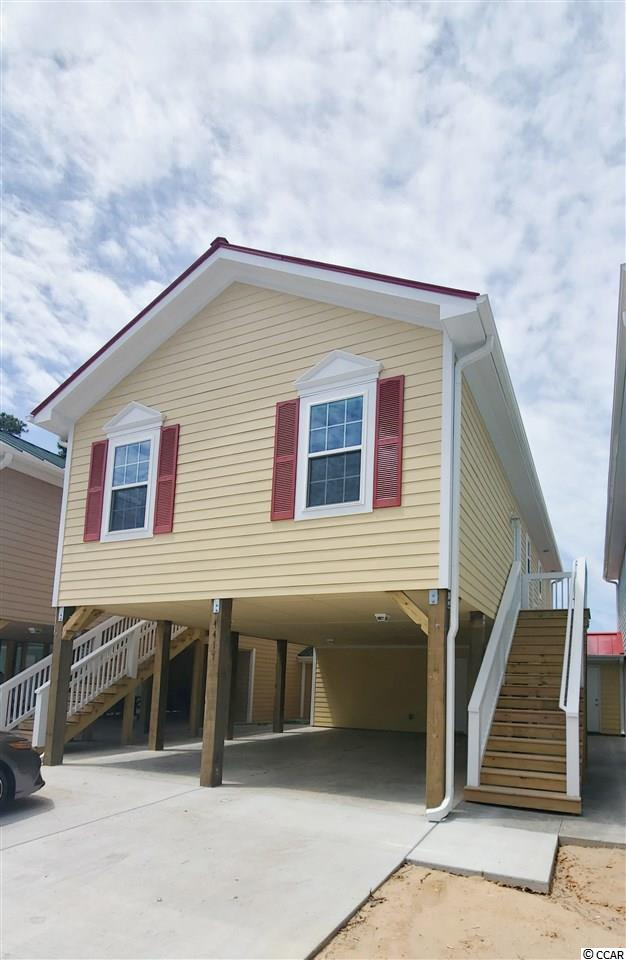 Welcome to Grande Harbour, a quaint community of cottages and raised beach homes annexed into the City of North Myrtle Beach. Grande Harbour is a natural gas community with its own dry stack marina and offers discounted marina services to homeowners! Features include custom cabinetry with soft close drawers/doors, granite counter tops, stainless steel appliances and luxury vinyl plank in all areas except the bedrooms, and more!  Exterior features include hardie plank siding, metal roof, tankless hot water heater, and attached storage room. Don't forget, the landscaping, yard maintenance, irrigation, pool, covered picnic area with  gas grill, even basic cable, internet, telephone, and security system with basic monitoring is all included in your HOA dues! Just seconds from the Intracoastal Waterway and minutes from Cherry Grove Beach (you can even get to the beach on your golf cart according to some homeowners).