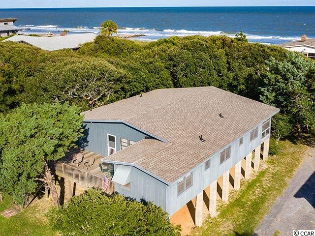 "Here it is!  The ""arrogantly shabby"" Pawleys Island beach house you've been searching for! It's that great old-school, beach house floor plan, with the kitchen open to the dining and living rooms in the center of the home, and 5 bedrooms on the sides. Enjoy the ocean breeze and the sound of the waves gently breaking on the shore from your rocking chair on the screened porch, or view the spectacular sunset over the marsh from the large front deck. It's comfortable. It's casual.  And it shares a private boardwalk to the beach with the other 3 homes around it. Aptly known to friends and family as ""Here Tis,""  450 Myrtle has an excellent rental history and is offered fully furnished.  The mid-island location right off the South Causeway makes it very convenient to the mainland, and far from public beach accesses. Other features include: New roof, outdoor shower, and large storage/laundry room under the house. Pawleys Island, one of the oldest summer resorts in America, is located about an hour north of historic Charleston and 30 miles south of the Myrtle Beach Airport. Pawleys Island is known for its shoeless, carefree, laid-back life style, which includes fishing, crabbing in the creeks, ghost stories, rope hammocks and a beautiful stretch of wide, sandy beach. On the mainland, you'll enjoy a variety of shopping, dining, golf, and excellent health care facilities. Pawleys Island is a great place to live!"