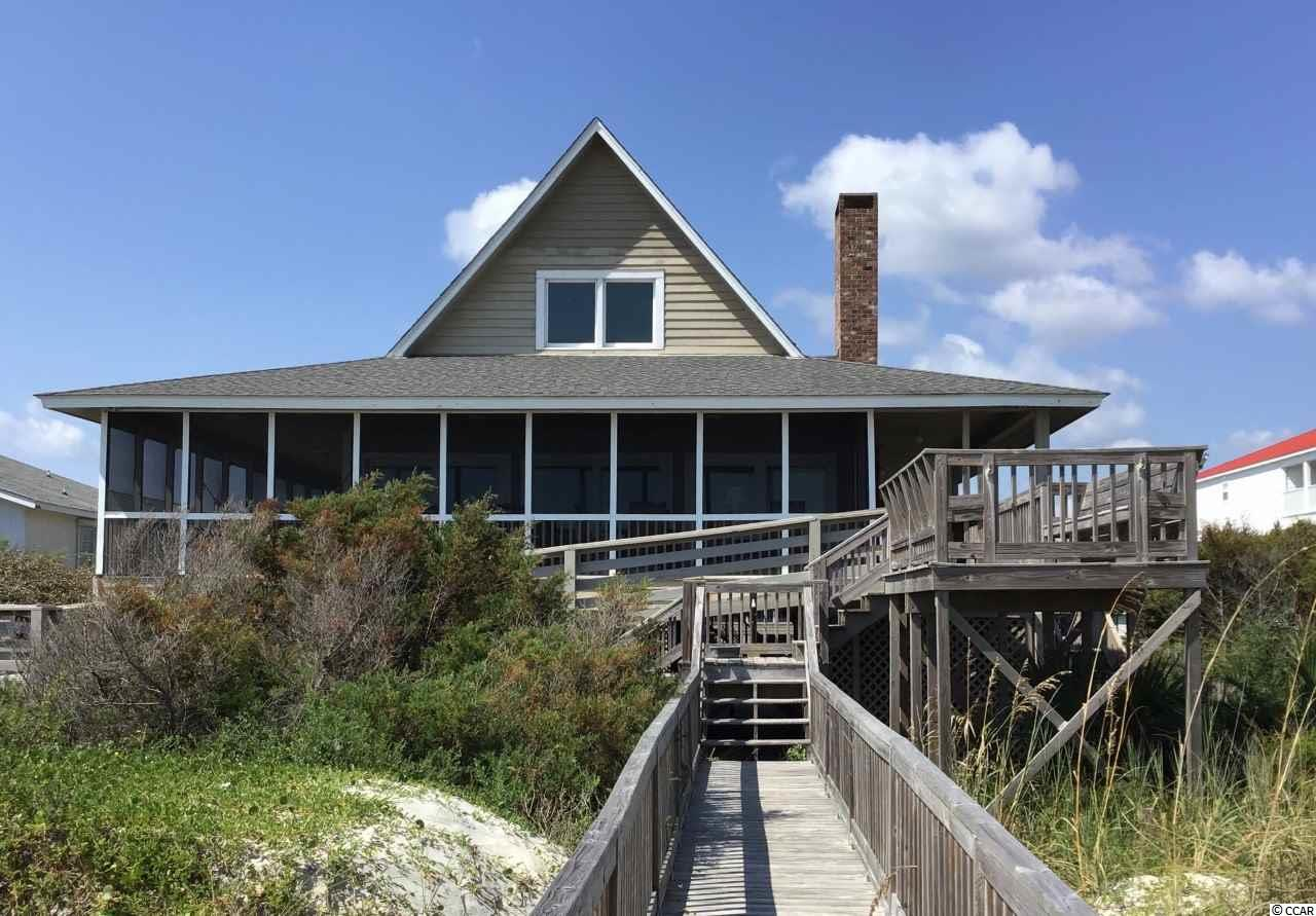 Oceanfront Delight!  Interval Ownership. Enjoy a Turnkey Oceanfront experience of Beach pleasure on the exclusive North end of Pawleys Island. Pack your bags and drive to the beach- leave all your cares behind-This interval ownership includes maid service so you'll arrive at a fresh clean beach home, beds made, linens, soaps, firewood, towels, just waiting for you! Melt into the swinging hammock on the big front porch! The owners favorite spot! Swinging to the ocean breezes, beach music wafting through the sliding glass doors, and the faint sound of a blender in the back reminds you that your margarita is coming soon!!! Tucked behind a big grassy dune the lull of the ocean puts you to sleep. Newly renovated kitchen w/ exquisite granite counters, stainless appliances, overlooks a dining room/ den w/ vaulted ceilings, snuggle up to the cozy fireplace. 2 Master suites,This home sleeps 10. Wheel chair accessable ramp, double sink on the ground level, outdoor shower and lots of parking below and outside. What are you waiting for, call your agent now to come see this lovely home!!