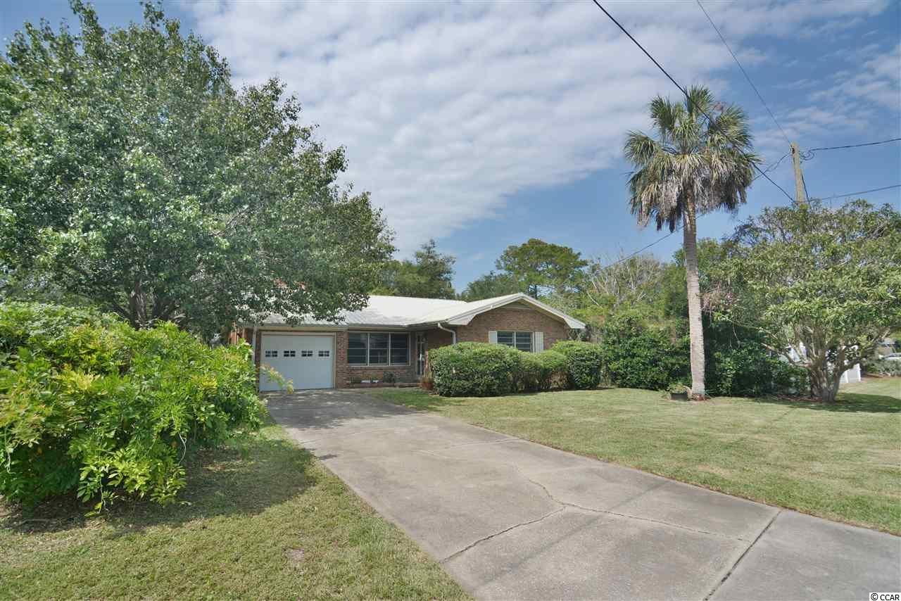 3bd/2ba all brick, single level home w/ large screened porch & fenced in yard - NO HOA & only 3 blocks to the beach! This is in the long-term area of Surfside beach and just a golf cart ride from the heart of popular Surfside Beach! Completely fenced in back yard is great for families with kids and/or pets. Enjoy hosting family get-togethers off the screened porch. Perfect as a primary residence, second home, OR investment property! This home boasts many upgrades including a fireplace and 1-car garage. Easy golf cart ride to all of the Surfside Beach and Garden City shops, restaurants, grocery stores, amusement rides, farmers' markets, and much more! Surfside Beach is just a short drive to everything Myrtle Beach has to offer including Coastal Grande Mall, Tanger Outlets, marinas, public docks, landings, restaurants, golfcourses, shops, entertainment, MyrtleBeach International Airport, Broadway At The Beach, The Market Common, Barefoot Resort andCoast Carolina University (CCU). Also,only 90 miles to beautiful Charleston, SC.
