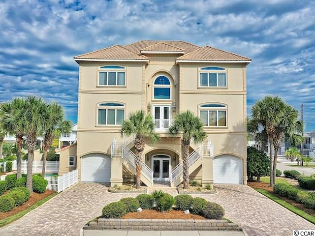 Welcome home to this fully furnished, custom-built, raised two-story home in the lovely Cherry Grove Beach community! This  4700 square feet home features a cavernous dual-bay garage underneath complete with RV hook-ups, a loop-style brick driveway providing plenty of parking space for guests, a vast rear balcony with views of both Hog Inlet and the Atlantic Ocean, a fenced yard with an in-ground pool and large pavestone deck around it, finished off with beautiful landscaping and palmetto trees. For convenience, there is a small pool house featuring its own sink, microwave, refrigerator, and bath. The home's main entrance is up the steps in front of the house, but there is also a ground entrance to the elevator so that the house is accessible to those with limited mobility. Inside you will appreciate the spacious feel thanks to the open floor plan and high ceilings. The vast living room fills with natural light thanks to several large windows and a built-in wet bar, providing the perfect space to entertain guests when it's too cold to lounge by the pool. An expansive tiled kitchen features a bay window over its granite countertops with tiled backsplashes and a large, granite-topped island and breakfast bar and easy serving access to the formal and informal dining areas.  The master bedroom suite has an enormous walk-in closet and en-suite bath featuring its own private sauna with gorgeous custom wood paneling and glass doors along with a large, fully-tiled walk-in shower and oversized jetted tub. The other three bedrooms mirror master suites, each featuring their own private baths and walk-in closets. This home represents luxury, beach living at it's best!