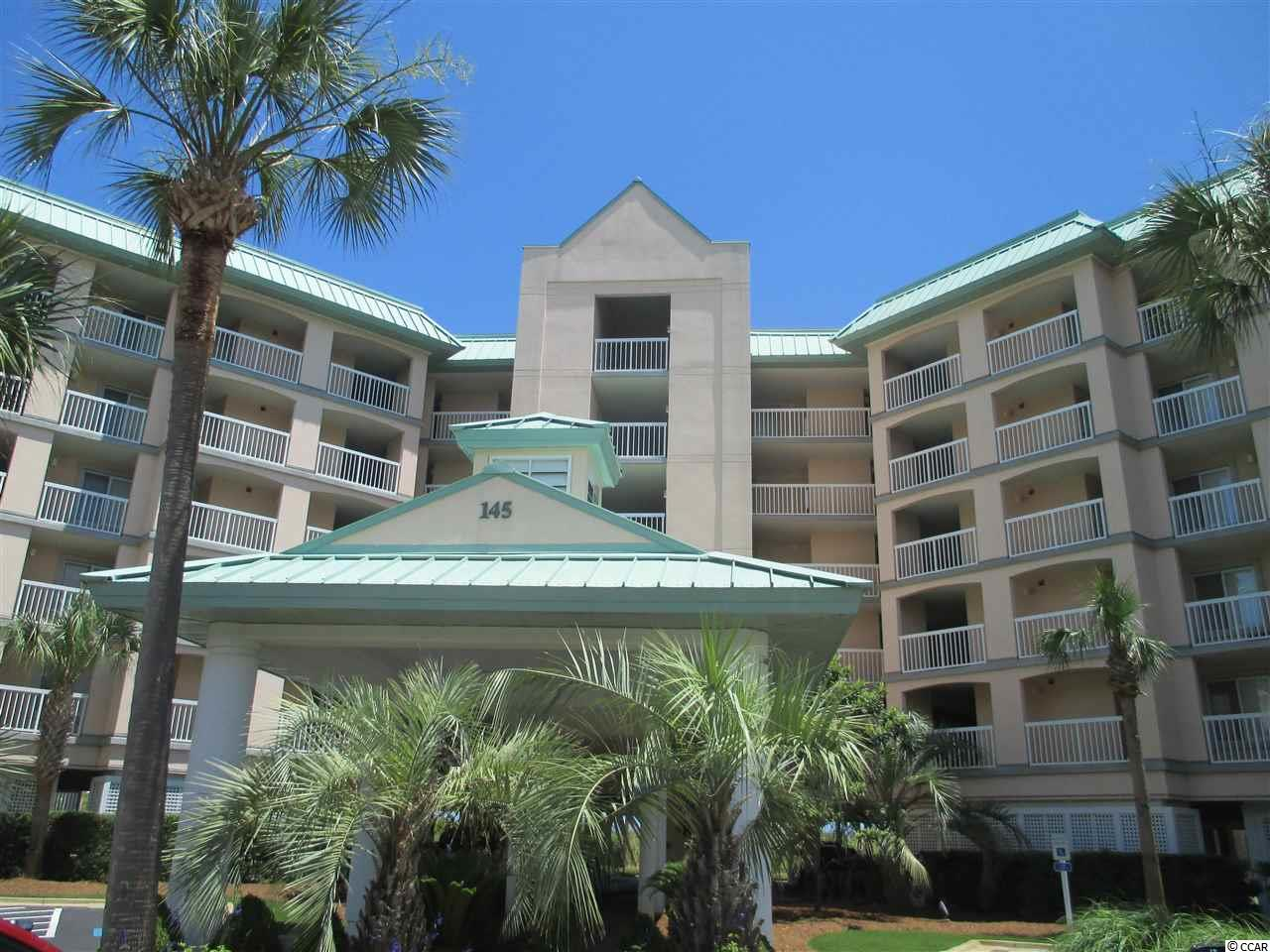 Wow! Want a knock dead gorgeous ocean front condo! Well this is it...109 Warwick with a complete remodel of living area, master bedroom and bath and kitchen. The condo now has the sophisticated decor rarely found in a beach villa. A few of the new features include: new pleasing paint colors, beautiful natural wood laminate floors, stainless appliances, new hardware thru out, elegant but comfortable furnishings, big screen TV, handsome new master bath, and a lovely ocean front porch furnishings that will functional as your favorite room in the villa.  This beautiful 3 bedroom, 3 bath condo is located ocean front at the wonderful resort of Litchfield by the Sea. The first floor location and private stairs from balcony with  reserved parking just below allows the condo to live like a secluded home...right in the heart of all the terrific amenities of Litchfield by the Sea. Come enjoy the beach, ocean and balmy breezes with tennis, pools, walking and bike trails, crabbing and fishing docks, beach club, and more right at your door step. Great rental history; new HVAC; beautifully remodeled and immaculately maintained.