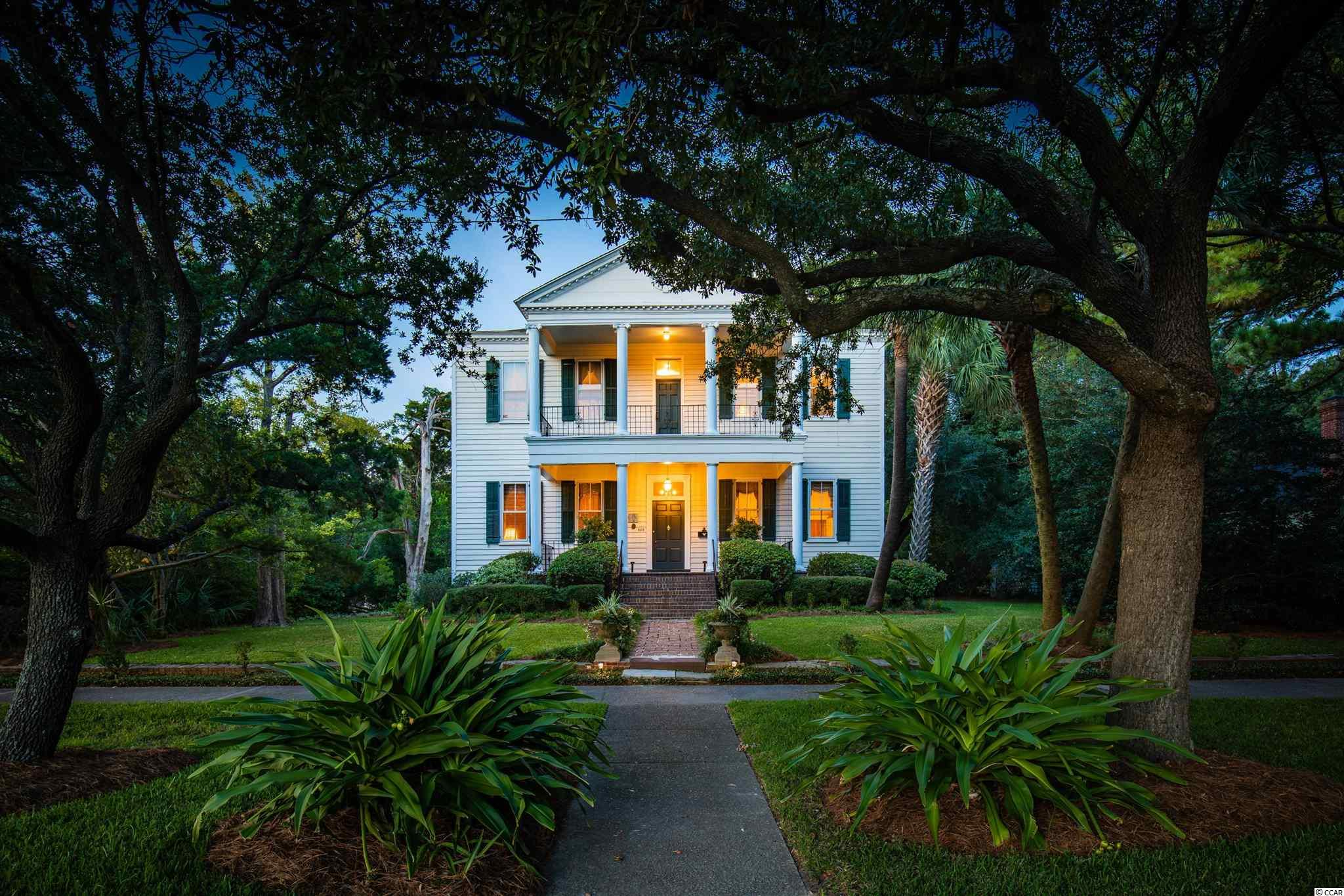 "Welcome to the Mary Man House.  Known as ""the mansion house on Bay Street,"" this elegant Georgian double house was built circa 1775 for in-town entertaining by Mansfield Plantation owner Miss Mary Man. She personally supervised the construction of her impressive dwelling on a high, double lot formerly owned by  Thomas Lynch, Sr., South Carolina delegate to the Second Continental Congress which produced the Declaration of Independence.    The Mary Man house is remarkable for how much original fabric remains intact -- from hand-hewn cypress construction resting  on a nearly 250-year-old brick  foundation to gleaming heart-of-pine flooring throughout. The house features a four over four plan with eight original fireplaces.  A classic portico provides a dramatic entrance for ""the grand house of the old settlement."" Entering the 5000 sq ft residence, a  wide  front hall reveals the magnificent space of  two formal rooms with twelve-foot ceilings:  a  living room with original  heart-of-pine paneling and a drawing room with half-moon and candlelight moldings.  A massive circa 1790 French Rococo giltwood mirror (a Man family piece that conveys) reflects the light of 19th-century Brockunier glass chandeliers (all four convey).  Beyond is the dining room, embellished with a large bay window and a pedimented cabinet for displaying silver, each with leaded glass.  You can entertain in the same spacious rooms and in the same gracious manner that Miss Mary Man enjoyed. The front hall staircase leads to the 18th-century ballroom (now the master bedroom and hall) where, in  December of 1812, legend says that the most famous woman of her time, Theodosia Burr Alston, of Oaks Plantation  (now part of Brookgreen Gardens)  was entertained at a ball held in her honor.(Theodosia, daughter of U.S. Vice President Aaron Burr -- who served under President Thomas Jefferson and who infamously killed Alexander Hamilton in a duel -- was the  wife of S.C. Governor Joseph Alston.  On the morning after the ball, Theodosia boarded the schooner Patriot,  which disappeared at sea, creating a nationwide sensation and mystery that endures to this day.)  An elaborate mantel and over-mantel crown the ballroom. The upstairs porch captures the breeze off Winyah Bay and shows to perfection the manicured grounds with native live oaks, palmettos, and azaleas.  Off the porch stands a gingko tree, planted by the second owner's family more than 100 years ago to honor one of their famous naval ancestors, Commodore Matthew C. Perry, who opened Japan to the West in 1854.  To the rear of the property past the foundation of the original kitchen stands a charming circa 1800 two-room kitchen building that was relocated to the property in 2008 and features a large central chimney.  With only two owners, the Man family of Mansfield Plantation and the Hazard family of Newport, Rhode Island, this remarkable 18th century dwelling was adapted to changing lifestyles and times over nine generations without the loss of its architectural integrity -- interior or exterior.  You, as only the third owner of the Mary Man house since the time of the  American Revolution, have an extraordinary opportunity to add your story to its amazing history.  This exceptional  property is located in the heart of the historic district and overlooks the colonial seaport of Georgetown, S.C.  International airports are conveniently located 90 minutes to the south in Charleston and 45 minutes to the north in Myrtle Beach.  Georgetown also boasts its own private airport and was voted USA Today's best small coastal city in America."