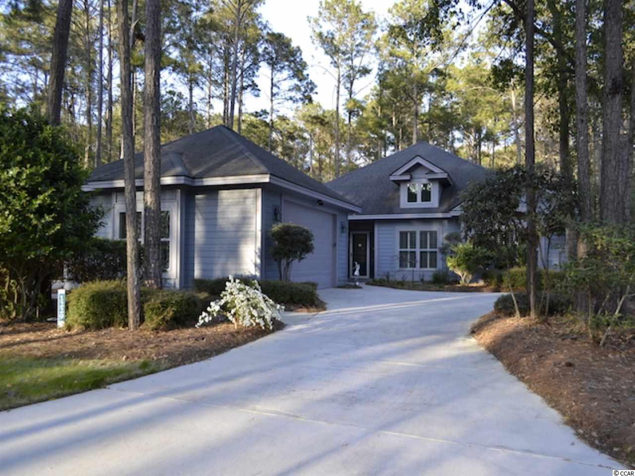 """Welcome to this 9 years young, spectacular, 3 bed, 3 bath, custom built contemporary home sitting on a rare double lot in the desirable Tidewater Plantation community!  With its 3,000 square feet of heated living space this home is one of the larger and newer homes in the Plantation neighborhood at Tidewater. Upon entering, you will step into an open and spacious living area with 20 foot high ceilings, extensive moldings, brand new flooring throughout the living area and all bathed in natural light. The open concept living space is further complimented by a double-sided fireplace and adjoining music/television room.  The home also features an exquisite Carolina Room with 3 walls of Kolby hurricane glass, a double tray ceiling, and private access to a cozy side patio featuring a pergola and fountain for relaxing. The gourmet kitchen features top of the line Shivakashi granite counters with full backsplash, top-of-the-line stainless steel appliances, and a gas range with a custom hood. The generous master suite includes a double tray ceiling with ceiling fan, walk-in closets and an en-suite bath with a large garden tub, dual sinks and a walk-in shower with artfully crafted blue granite and tile. The other two large bedrooms, one of which can also be used as an office and includes a custom designed """"More Space"""" bedding unit, share access to the second lovely bath with a vessel sink, marble floors and double-head shower with crafted tile. It also features a mud/laundry room with a 3rd bathroom perfectly placed for a shower after your return from the beach.  The outdoor space offers a private backyard patio with mature landscaping. A circular driveway leads to an adjoining one-of-a kind """"drive through"""" oversized two-car garage with custom cabinets and floor covering. The home also features a security system, built-in speakers throughout, Rinnai hot water system, irrigation, and CertainTeed all weather board exterior siding. Tidewater Plantation residents also enjoy an oc"""